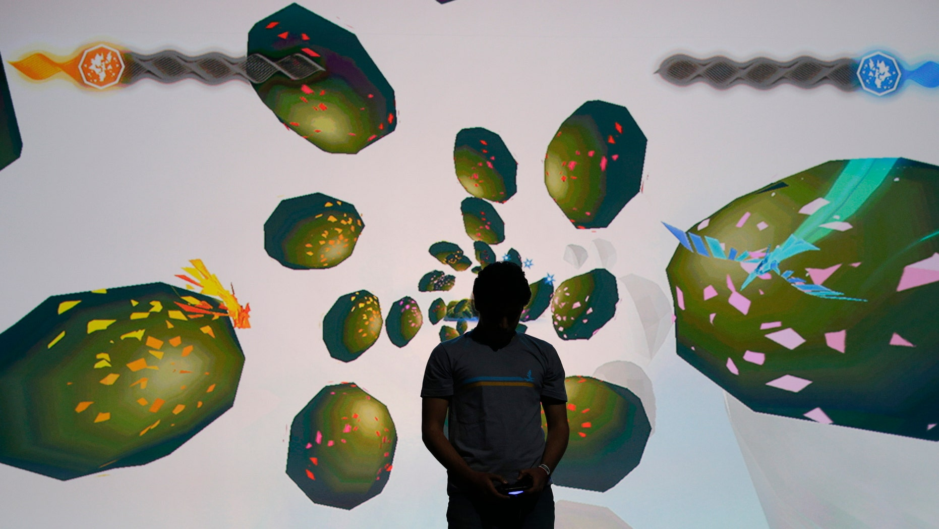 "June 9, 2014: A gamer plays the ""Entwined"" video game during Sony's PlayStation press event at the Electronic Entertainment Expo on Monday, in Los Angeles. Sony is bringing its PlayStation TV video- and game-streaming device to North America and Europe this fall."
