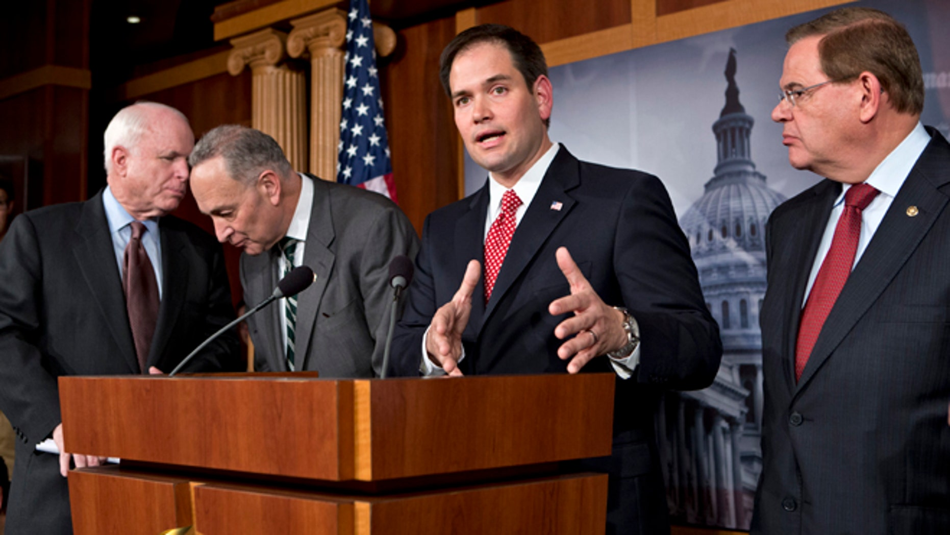 FILE â In this Jan. 28, 2013, file photo Sen. Marco Rubio, R-Fla., center, speaks at a Capitol Hill news conference on immigration legislation with a members of a bipartisan group of leading senators, including, from left, Sen. John McCain, R-Ariz., Sen. Chuck Schumer, D-N.Y. and Sen. Robert Menendez, D-N.J., in Washington. After months of arduous closed-door negotiations, the âGang of Eightâ senators equally divided between the two parties had no issues left to resolve in person, and no more negotiating sessions were planned. Remaining details were left to aides, who were at work completing drafts of the bill. (AP Photo/J. Scott Applewhite, File)