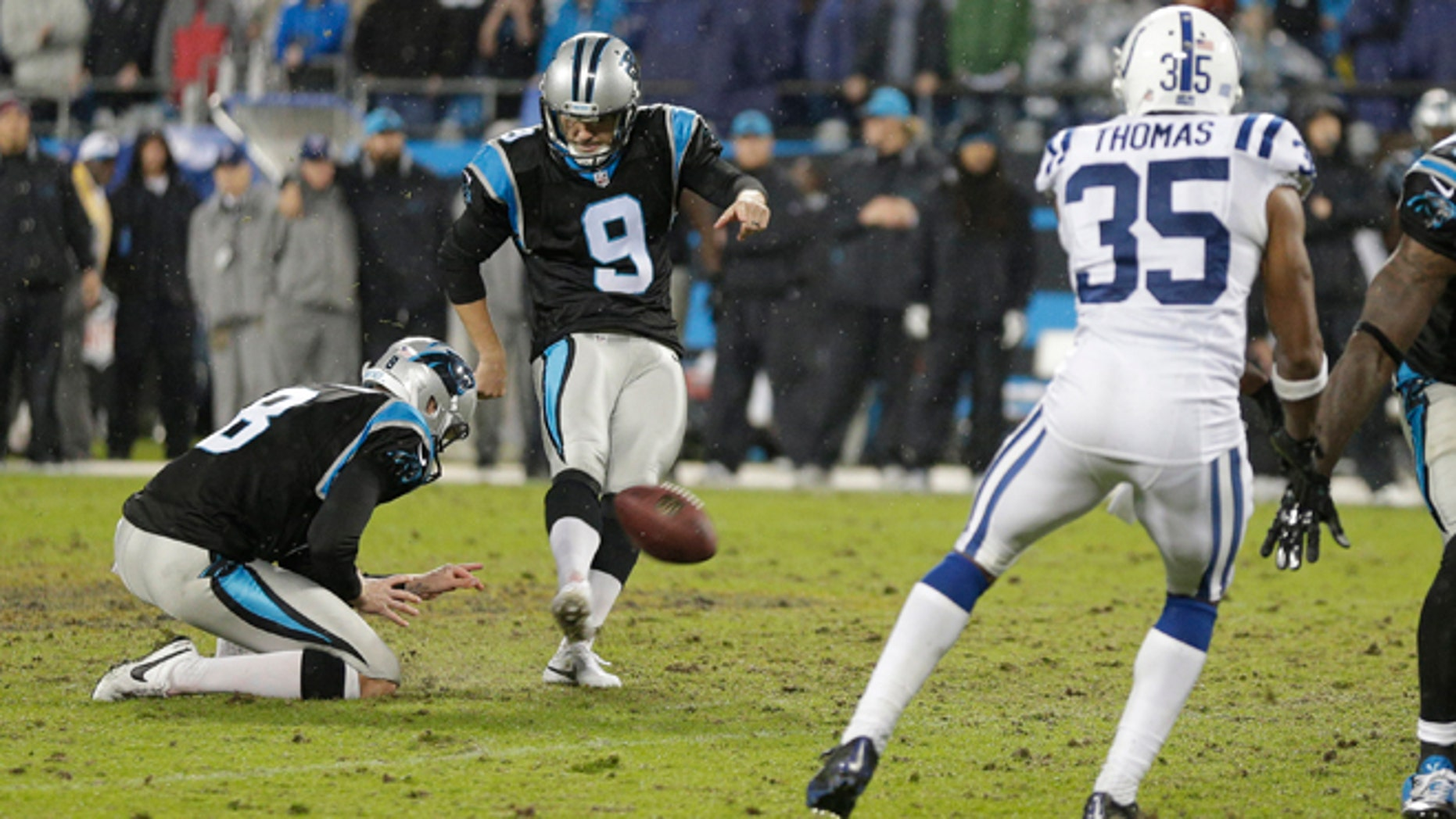 Carolina Panthers' Graham Gano (9) kicks the game-winning field goal in overtime against the Indianapolis Colts in an NFL football game in Charlotte, N.C., early Tuesday, Nov. 3, 2015. The Panthers won 29-26. (AP Photo/Chuck Burton)