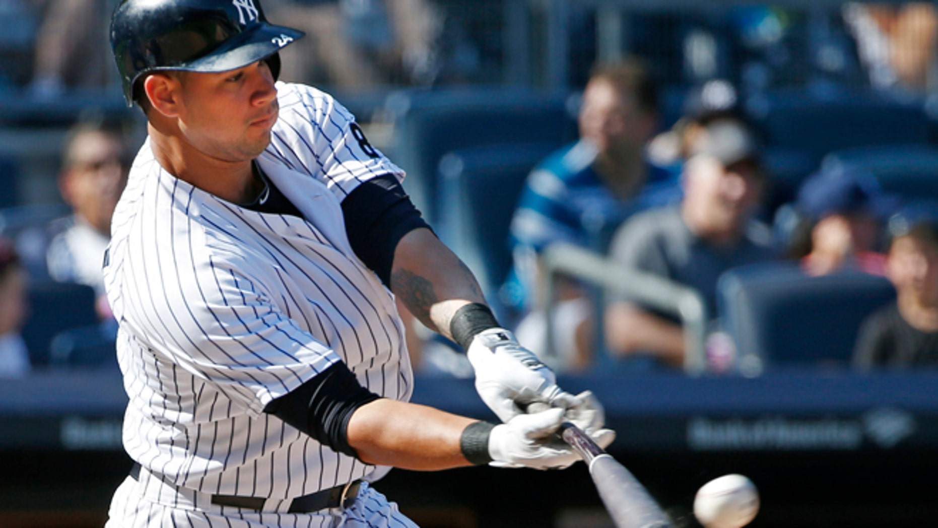 New York Yankees designated hitter Gary Sanchez (24) hits an eighth-inning double in a baseball game against the Baltimore Orioles in New York, Sunday, Aug. 28, 2016. (AP Photo/Kathy Willens)