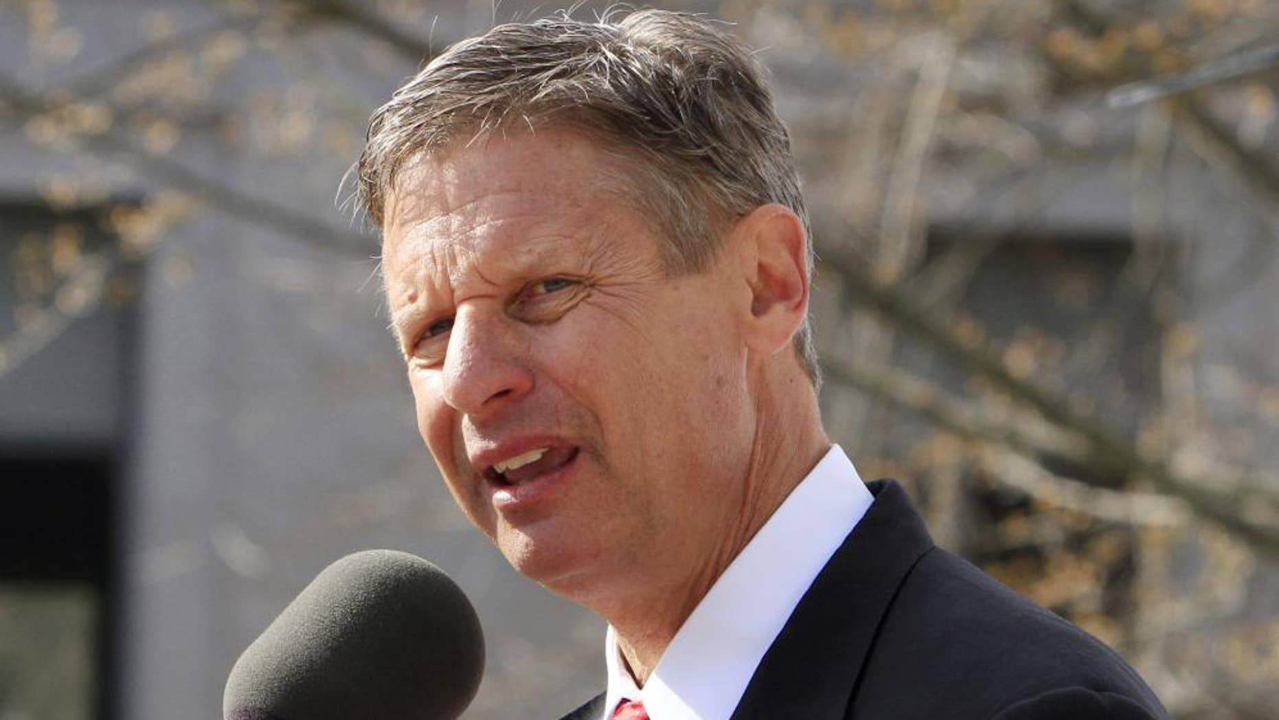 Former New Mexico Gov. Gary Johnson announces his plans to seek the Republican nomination for president in front of the Statehouse Thursday, April 21, 2011 in Concord, N.H. (AP Photo/Jim Cole)