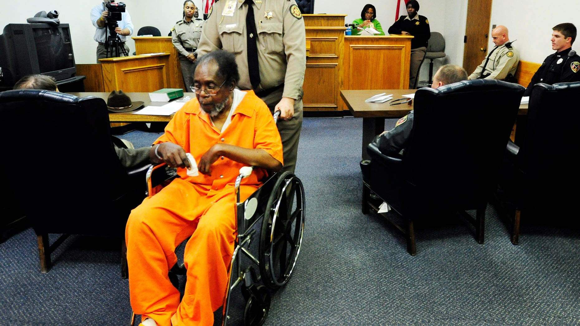 Dec. 4, 2012: Frank Louis Reeves is wheeled out of the courtroom after his first appearance in Macon Ga. No bond was set Wednesday afternoon, Dec. 5, 2012, for Reeves who is accused in the death of a woman outside a Gray Highway gas station after his motorized wheelchair bumped her car.