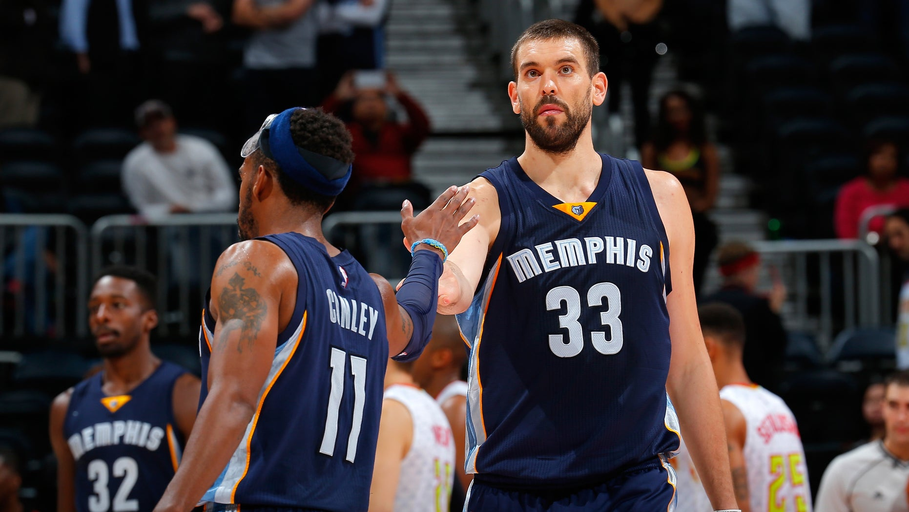 Mike Conley and Marc Gasol at Philips Arena on October 21, 2015 in Atlanta, Georgia.
