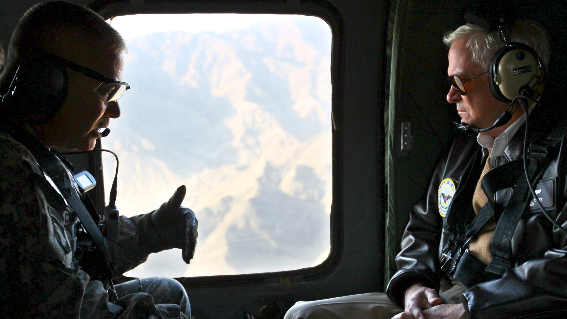 Dec. 7: Defense Secretary Robert Gates, right, receives a briefing from Major Gen. John Campbell, left, as they fly aboard a helicopter over Kunar Province, Afghanistan. The U.S. and NATO predict heavier fighting this winter.