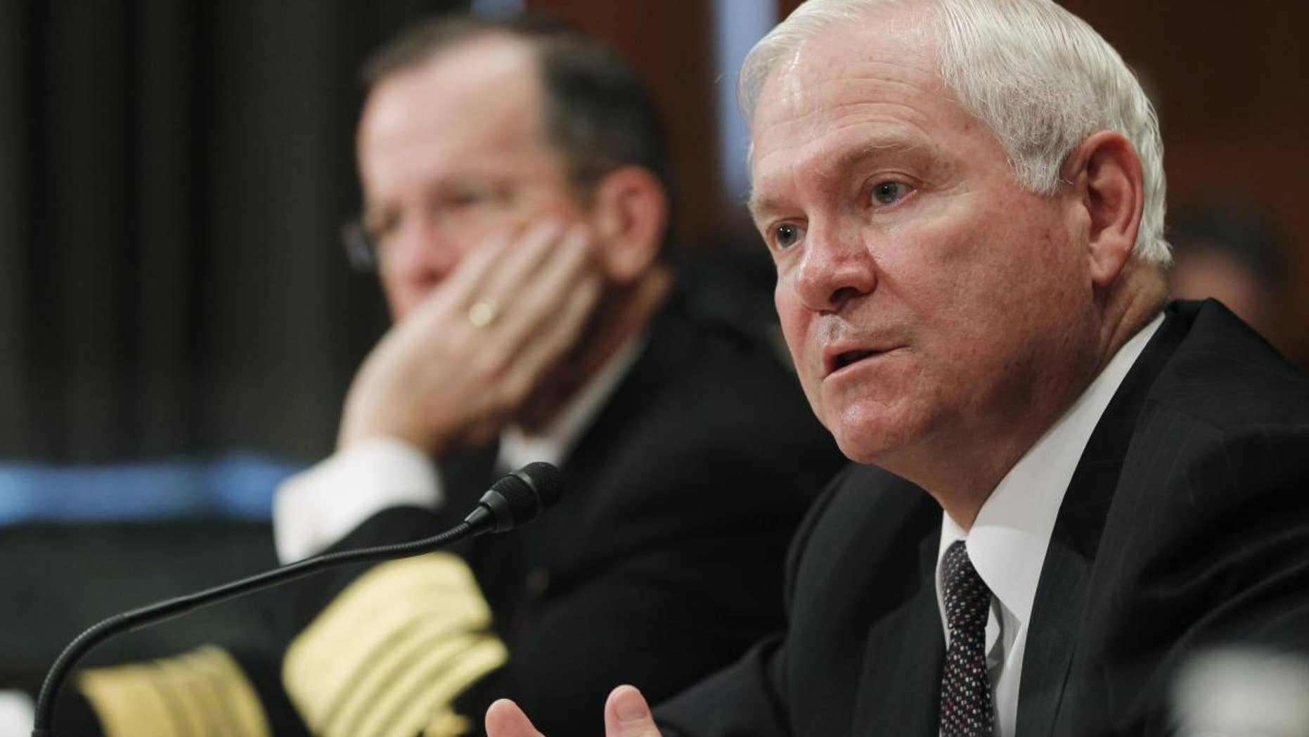 Secretary of Defense Robert Gates and Chairman of the Joint Chiefs of Staff Adm. Michael Mullen testify regarding the Department of Defense Fiscal Year 2012 budget request before the Senate Appropriations Committee Subcommittee on Defense on Capitol Hill in Washington, Wednesday, June 15, 2011. (AP Photo/Charles Dharapak)