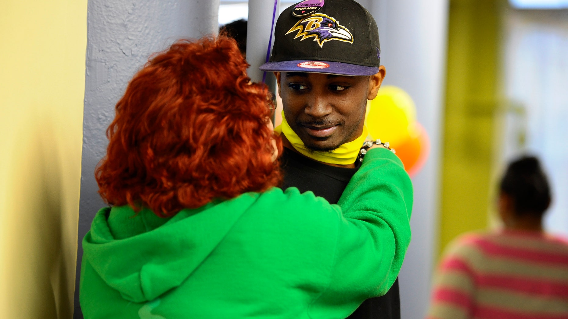 April 19, 2013: Quincy Wright, right, is hugged by a friend during a breaking the silence gathering at True Colors in Hartford, Conn.