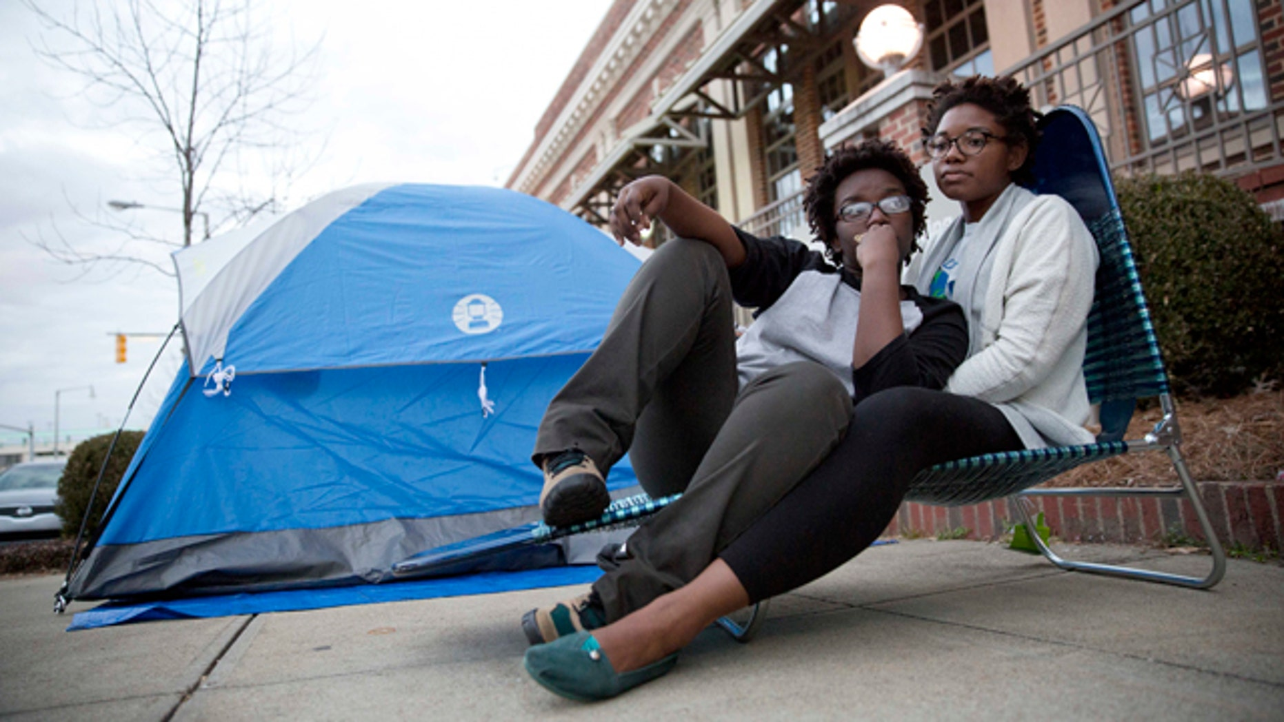 Feb. 8, 2015: Shanté Wolfe, left and Tori Sisson, right, sit near the Montgomery County Courthouse Sunday in Montgomery, Ala. Wolfe and Sisson camped out all night on Sunday to be the first couple to marry in Montgomery on Monday morning. (AP Photo/Brynn Anderson)