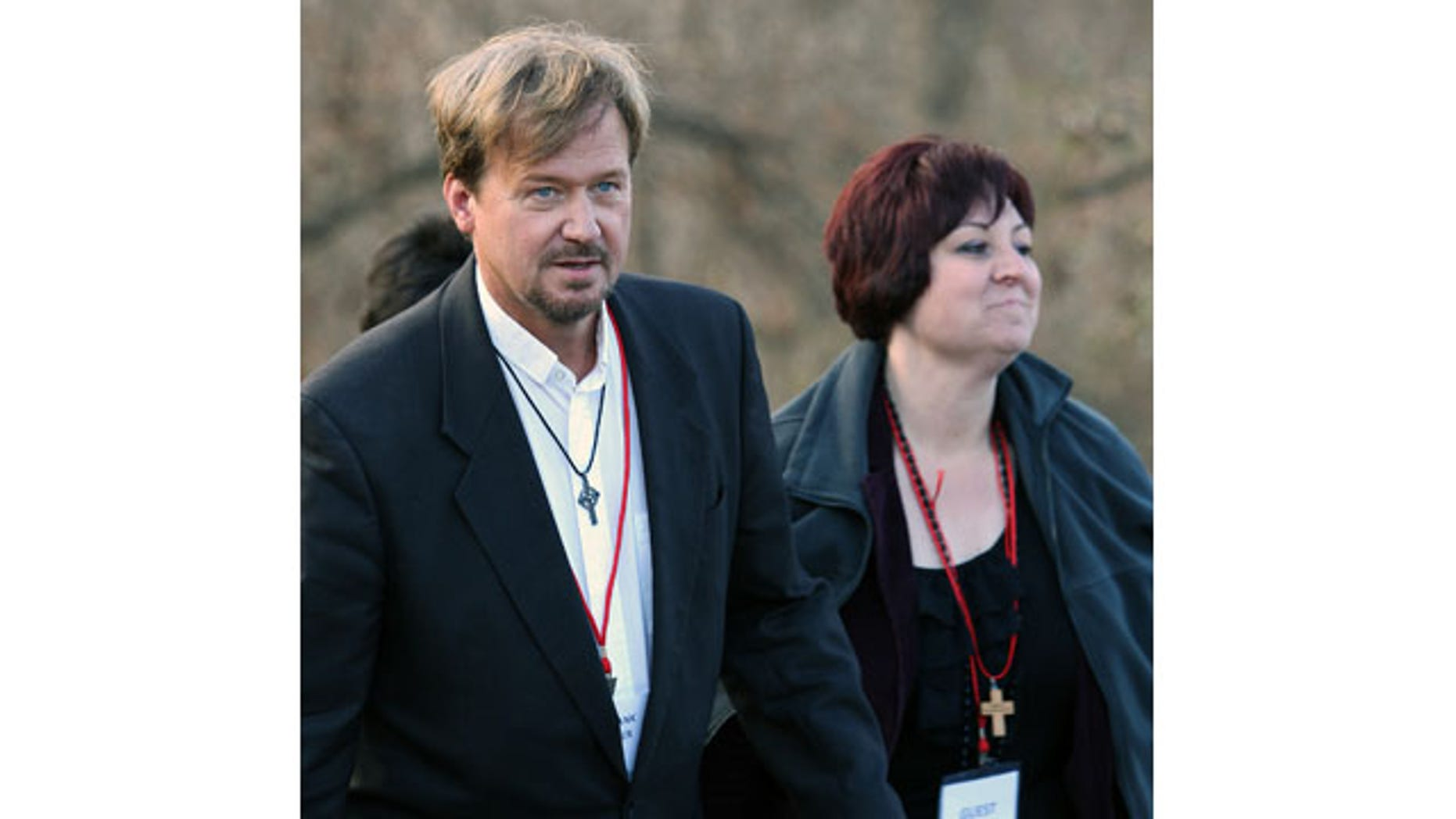 November 19. 2013: The Rev. Frank Schaefer, left, of Lebanon Pa., and his Pastoral Assistant Clydette Overturf, comes back to the trial after a lunch break at Camp Innabah, a United Methodist retreat, in Spring City Pa. A jury of his pastoral peers convicted Schaefer on Monday of breaking his vows by officiating his gay sons' Massachusetts wedding in 2007. (AP Photo)