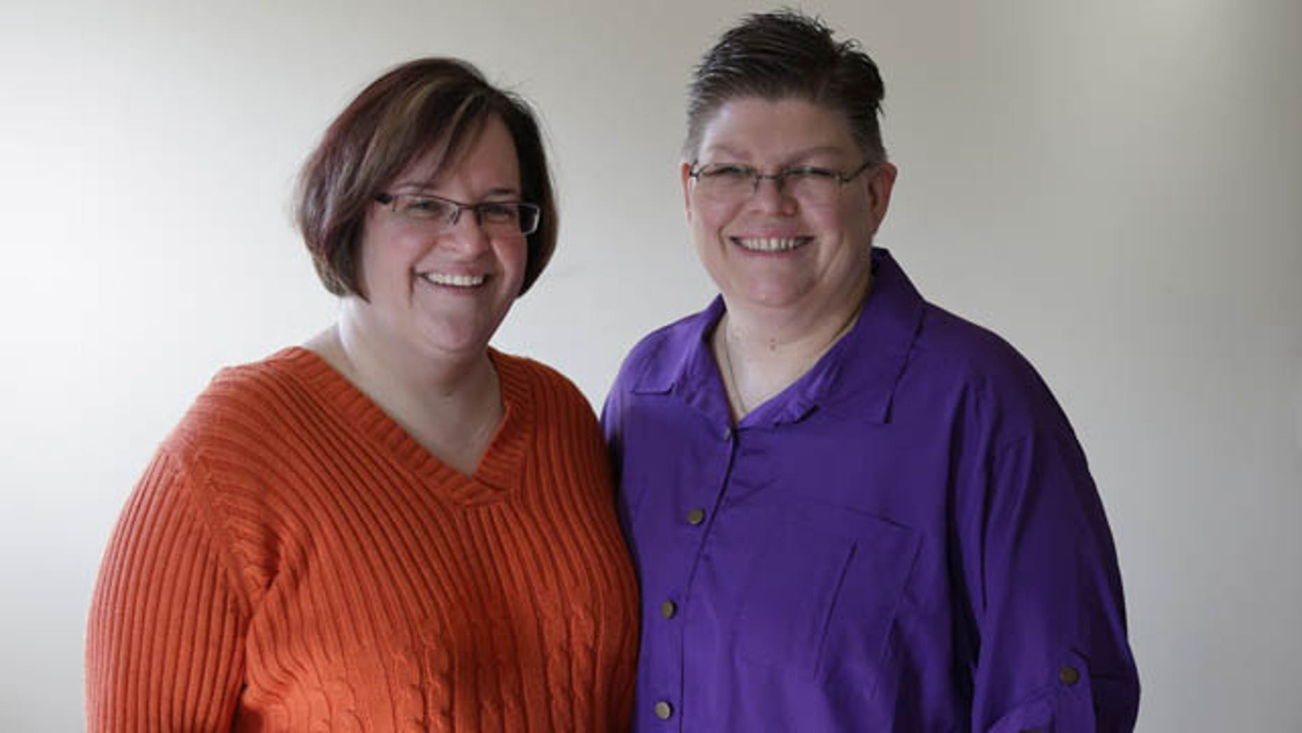 FILE - In this March 5, 2013 file photo, April DeBoer, left, and Jayne Rowse, and pose at their home in Hazel Park, Mich. (AP Photo)
