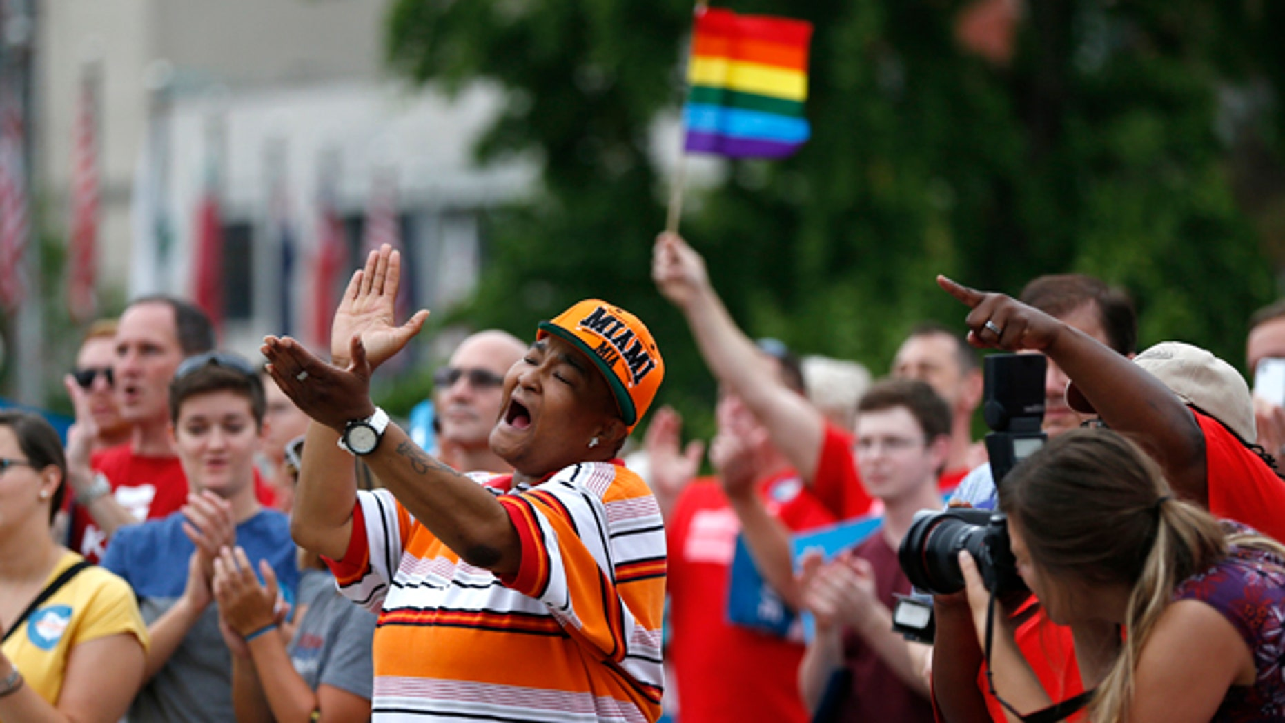 August 5, 2014: Corey Smith of Mt. Healthy, Ohio joined hundreds of others along with the group Why Marriage Matters Ohio at a rally for gay marriage in Lytle Park in Cincinnati. Federal appeals courts soon will hear arguments in gay marriage fights from nine states, part of a slew of cases putting pressure on the U.S. Supreme Court to issue a final verdict. (AP Photo/The Cincinnati Enquirer, Jeff Swinger)
