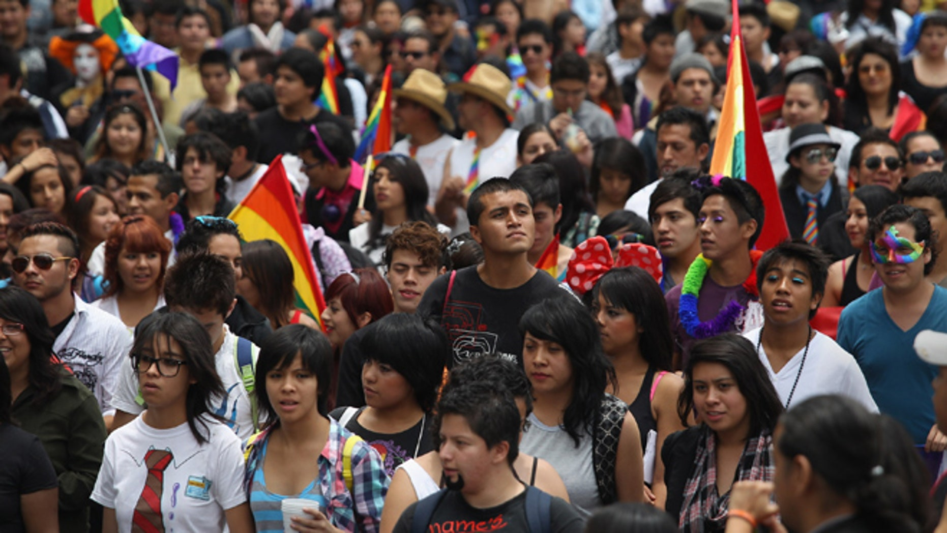 MEXICO CITY, MEXICO - JUNE 30:  Thousands of people fill Mexico City's Paseo de la Reforma during a gay pride march on June 30, 2012 in Mexico City, Mexico. Mexicans go the polls Sunday for presidential elections.  (Photo by John Moore/Getty Images)
