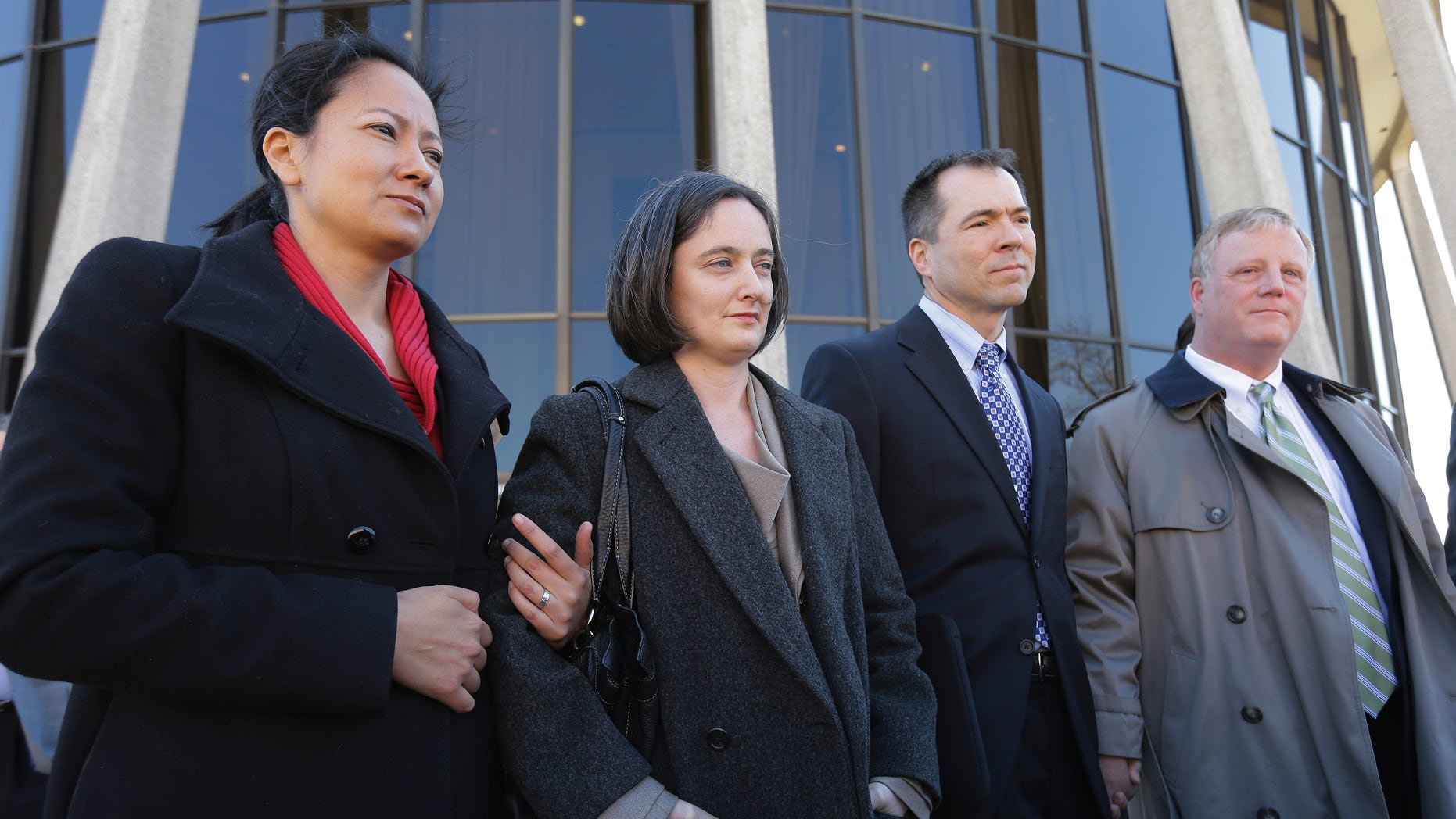 Feb. 14, 2014: The two homosexual couples who challenged Texas' ban on same-sex marriage, Cleopatra De Leon, left, and partner, Nicole Dimetman, second from left, and Victor Holmes and partner Mark Phariss, right, talk with media.