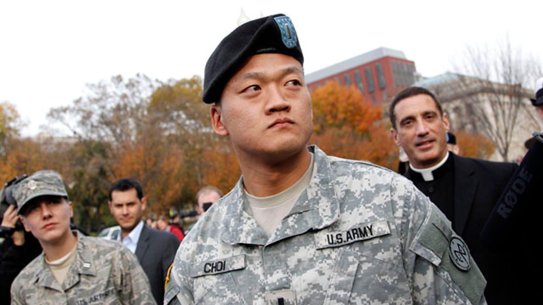 Nov. 15: Lt. Dan Choi, center, is seen in front of the White House in Washington, D.C., moments before he handcuffed himself to the fence of the White House during a protest for gay rights. (AP)