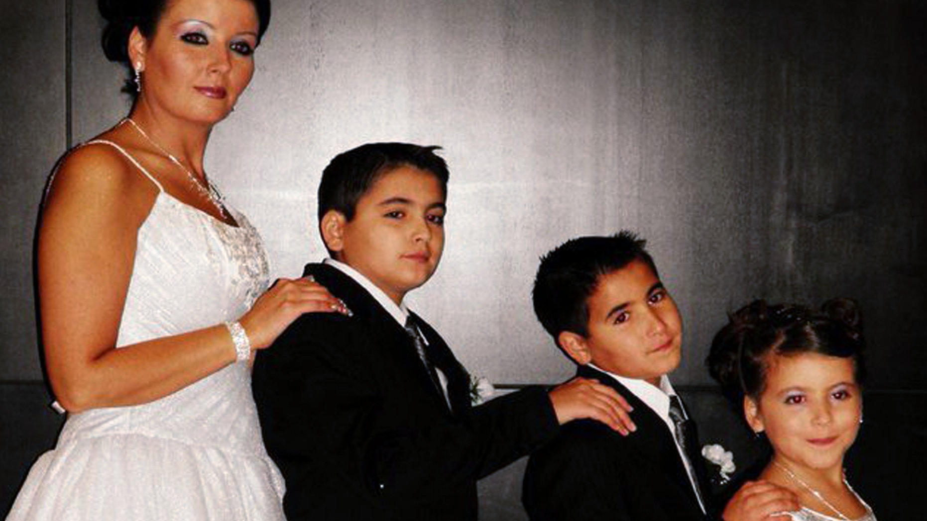 FILE: Bethany Gonzales poses with her three children, 13-year-old Jehed, 10-year-old, Edhem, and 9-year-old Jannah