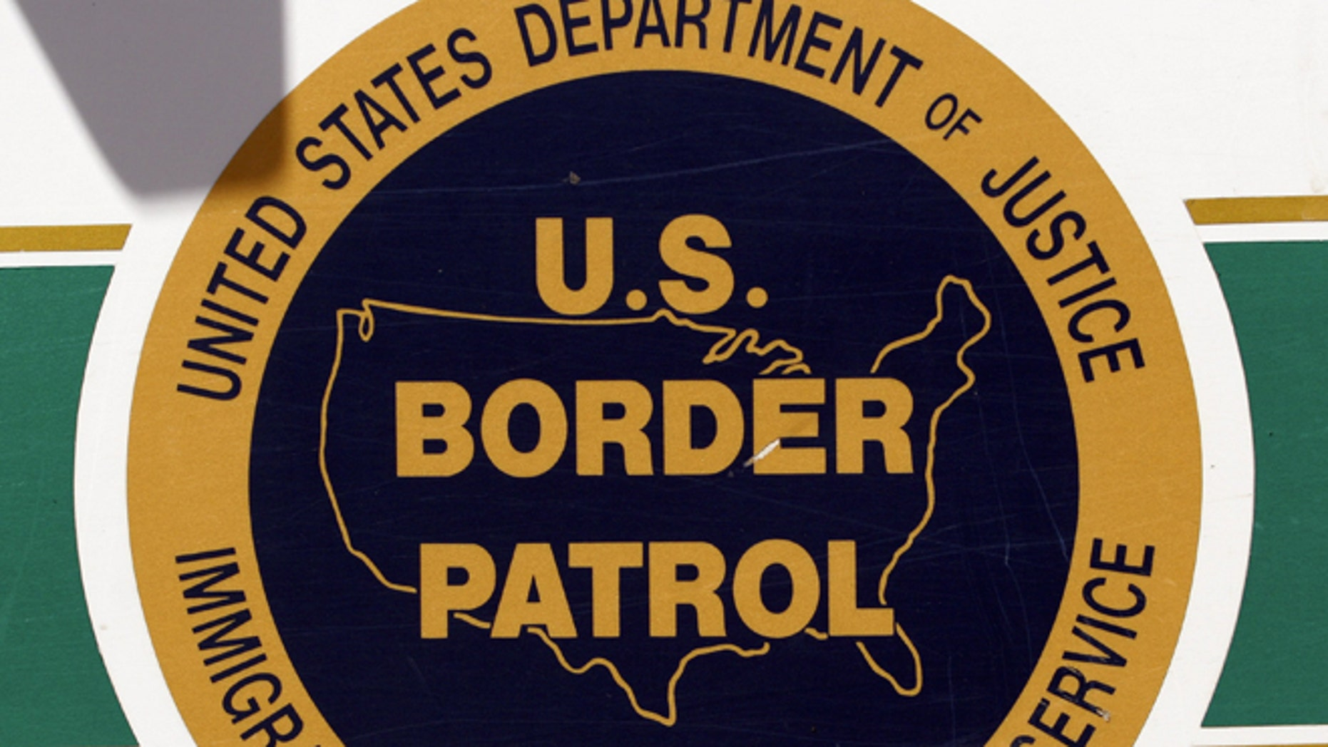 NOGALES, AZ - MAY 14:  The U.S. Border Patrol emblem is seen on the side of an agent's truck patrolling the border May 14, 2006 in Nogales, Arizona. U.S. President George W. Bush will address the nation on the immigration issue May 15.  (Photo by Jeff Topping/Getty Images)
