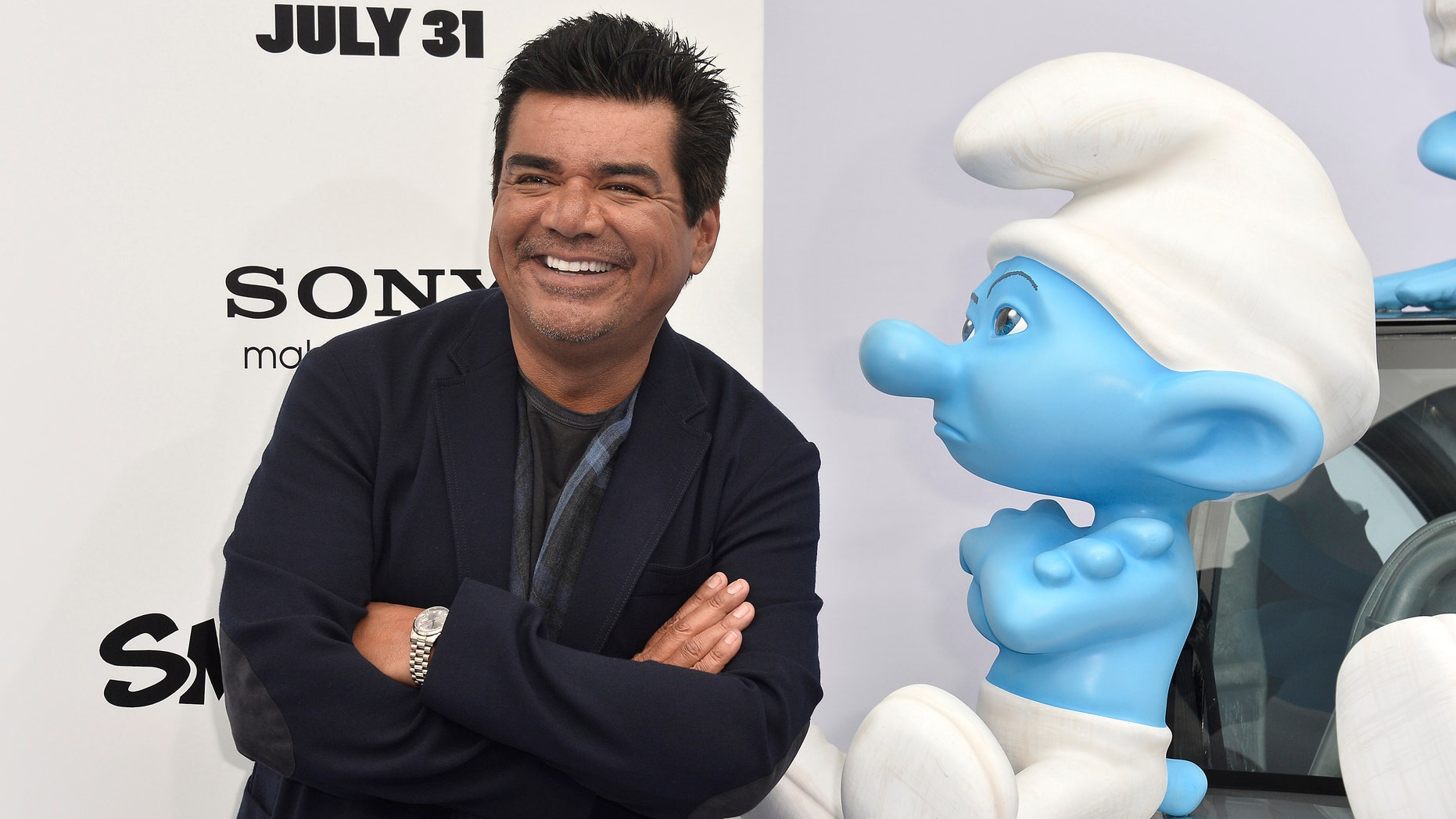 """WESTWOOD, CA - JULY 28:  Actor George Lopez attends the premiere of Columbia Pictures' """"Smurfs 2"""" at Regency Village Theatre on July 28, 2013 in Westwood, California.  (Photo by Frazer Harrison/Getty Images)"""