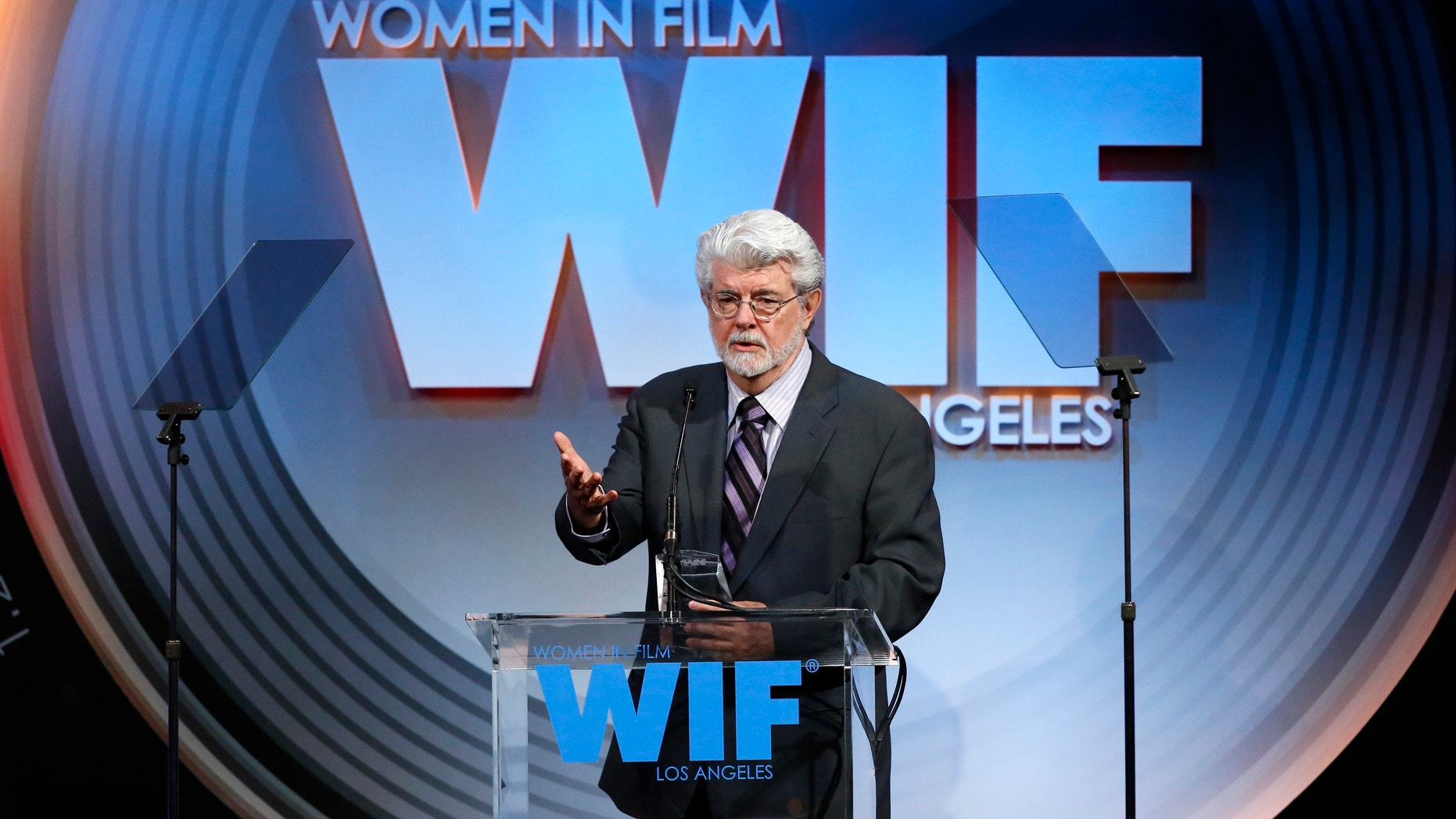 Director and producer George Lucas accepts the Norma Zarky Humanitarian award at the Women In Film Los Angeles 2013 Crystal and Lucy Awards in Beverly Hills, California June 12, 2013.
