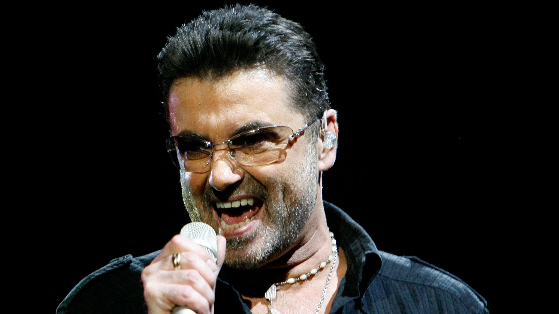 """June 25, 2008: George Michael performs in concert at the Forum during his """"Live Global Tour"""" in Inglewood, California. The singer was recently arrested in Britain on charges of drugs and driving offenses."""