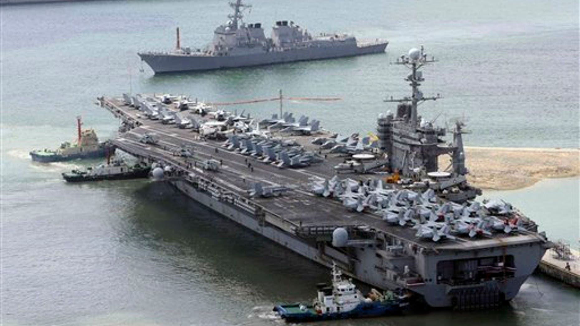 July 21: The massive USS George Washington aircraft carrier is escorted into the Busan port in South Korea for joint military exercises.