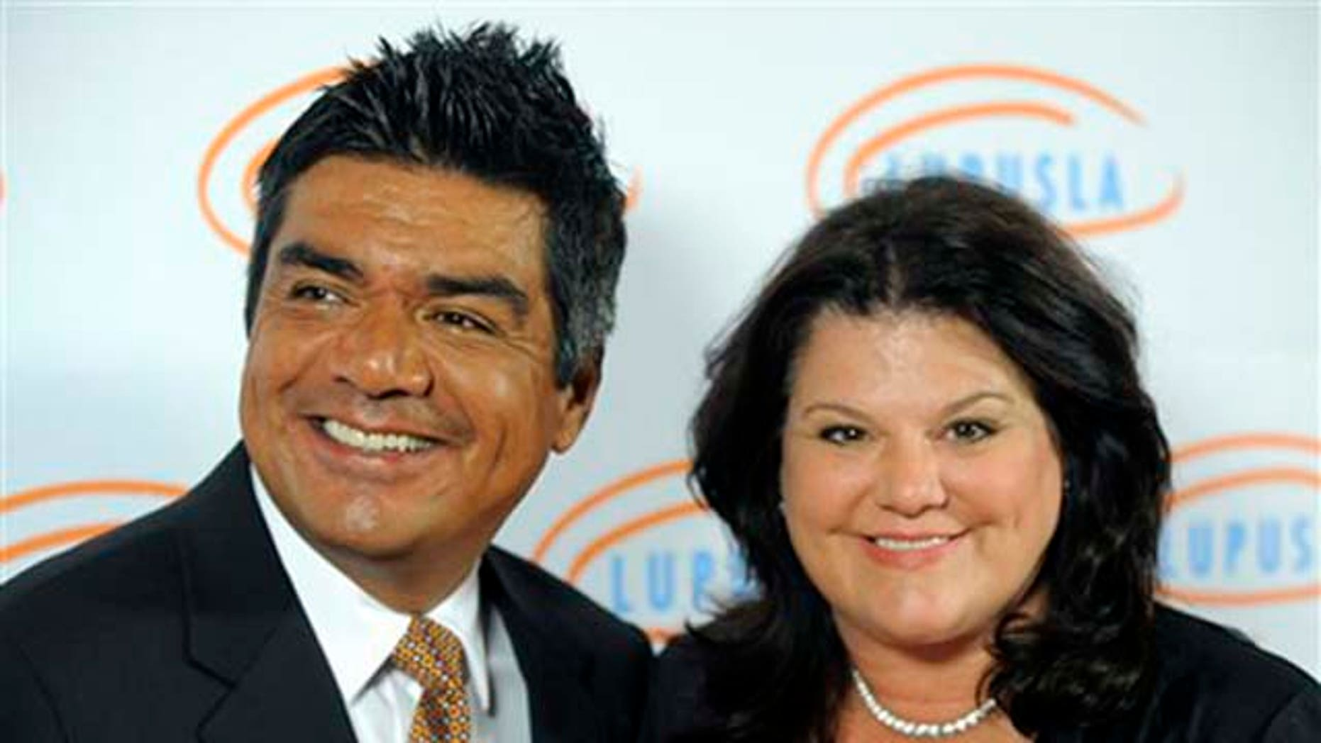 FILE - In this May 6, 2010 file photo, TV personality George Lopez and his wife Ann arrive at the 10th Annual Lupus LA Orange Ball in Beverly Hills, Calif. (AP Photo/Chris Pizzello, file)