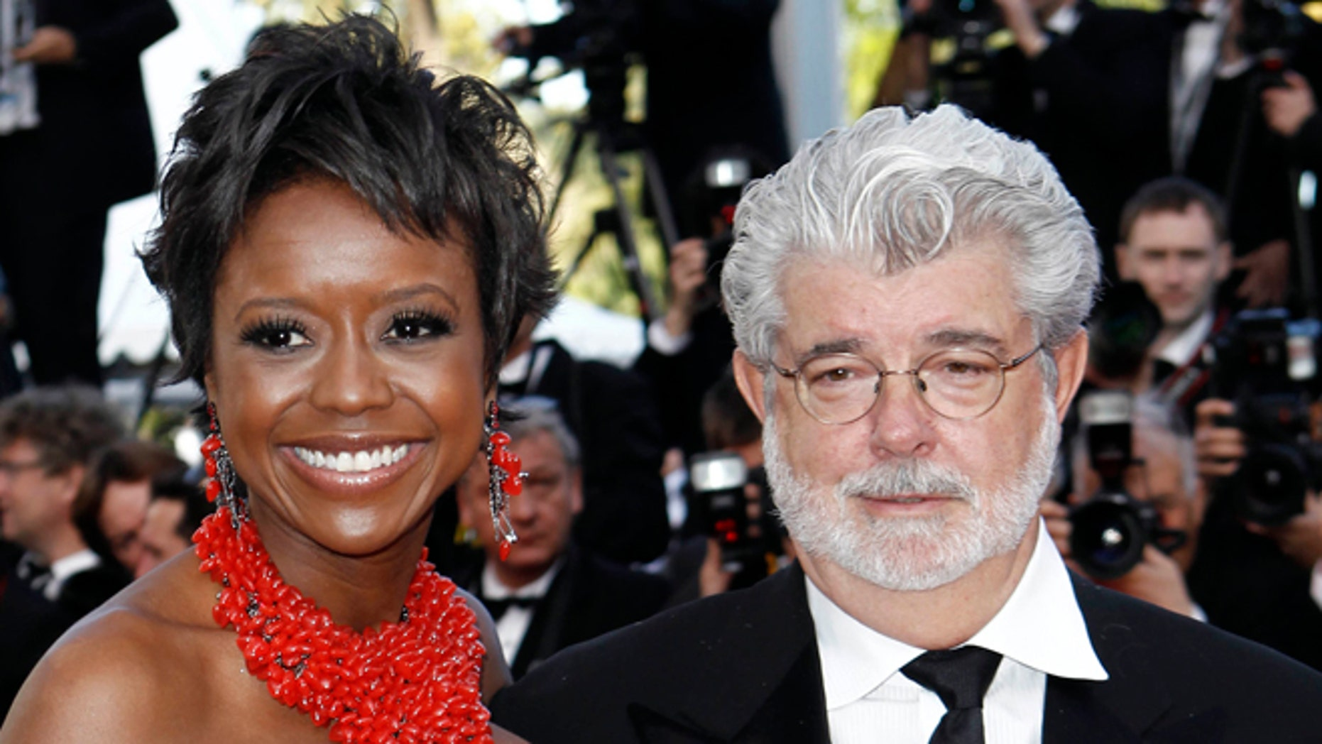 """May 14, 2010: In this photo, Filmmaker George Lucas, right, and Mellody Hobson arrive for the screening of """"Wall Street Money Never Sleeps"""", at the 63rd international film festival, in Cannes, southern France."""