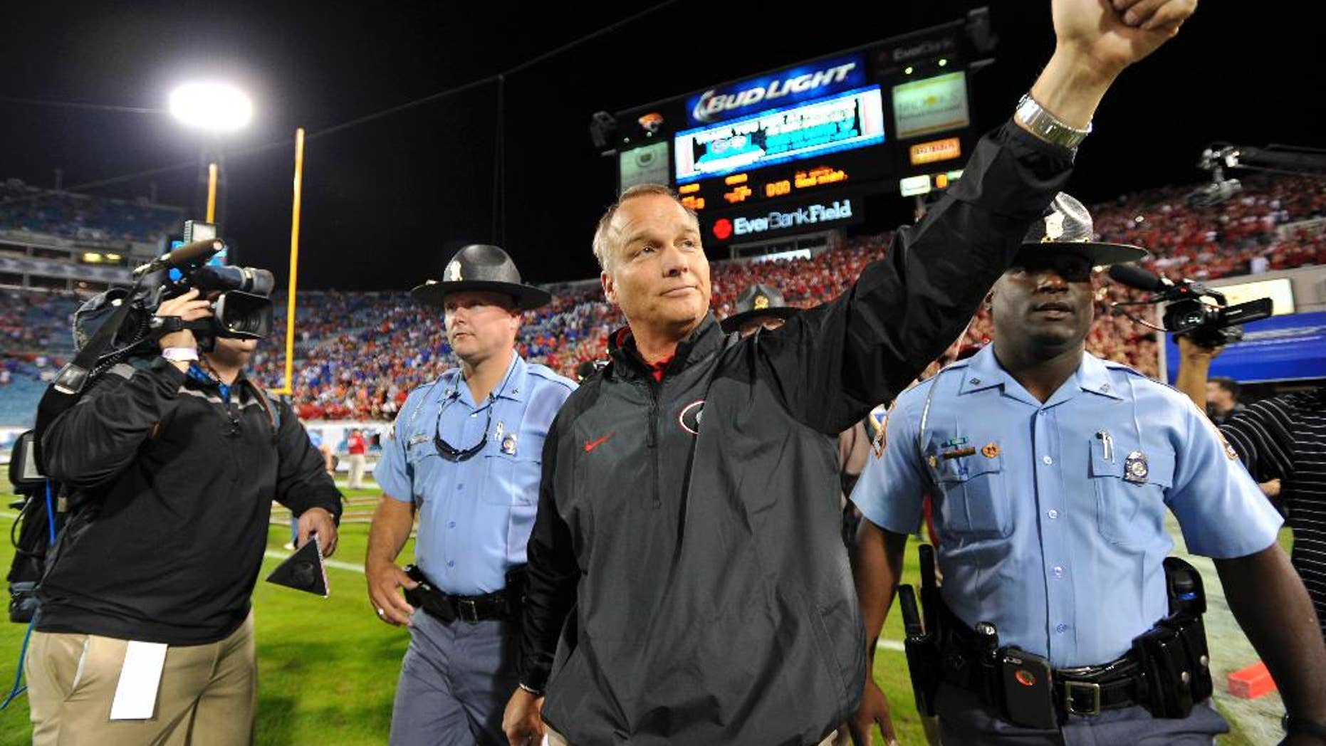 FILE - In this Nov. 2, 2013, file photo, Georgia head coach Mark Richt gives a thumbs up to the fans after their 23-20 win over Florida in an NCAA football game in Jacksonville, Fla. On Saturday, Nov. 1, 2014, the Bulldogs will be going for their fourth straight victory in the series for the first time since the 1980s. (AP Photo/Athens Banner-Herald, AJ Reynolds, File) MAGS OUT; MANDATORY CREDIT