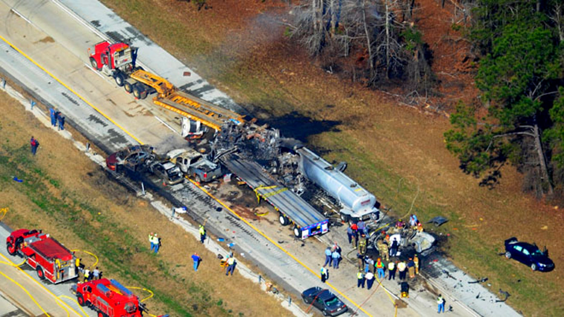 Feb. 6, 2013: Emergency workers and firemen are at he scene of a pile up on Interstate 16 near Jeffersonville, Ga.