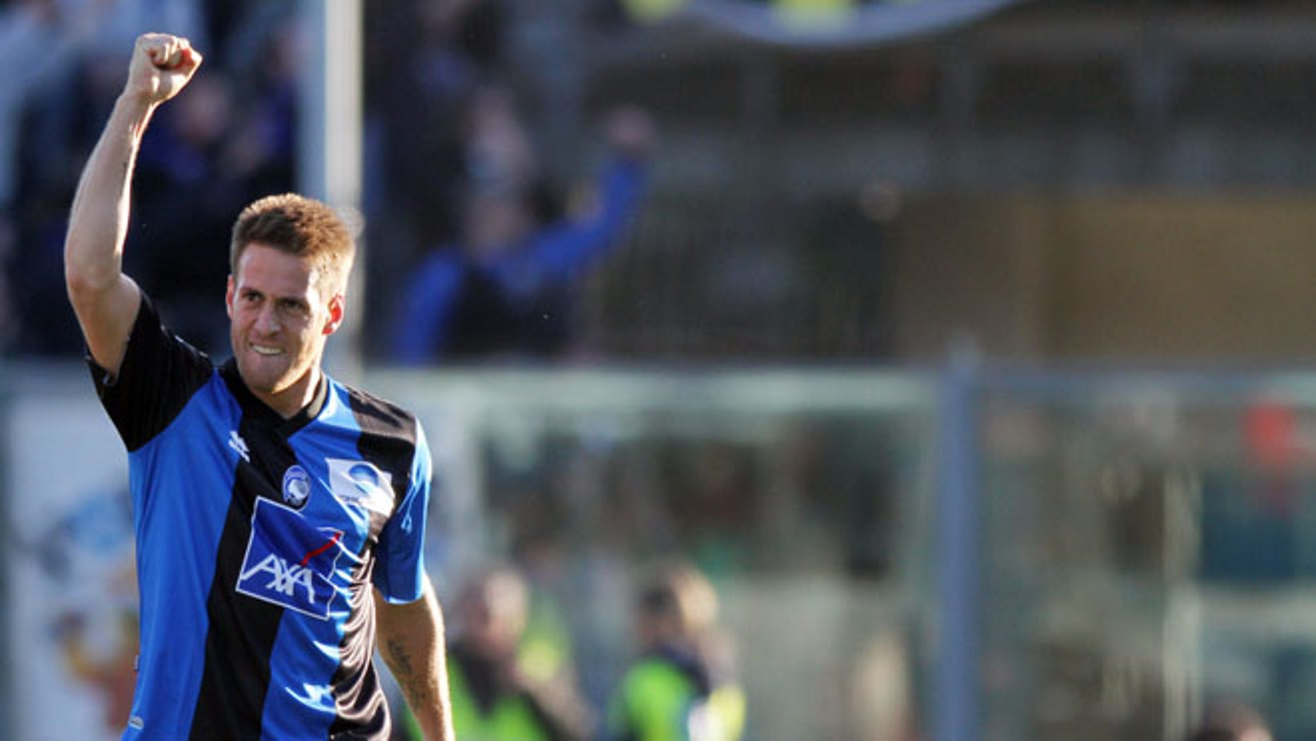 Atalanta's German Denis, of Argentina, reacts after scoring during a Serie A soccer match against AS Roma in Bergamo, Italy, Sunday, Feb. 26, 2012. (AP Photo/Felice Calabro')