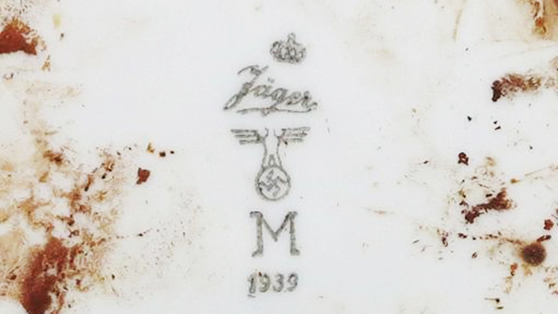 Nov. 21, 2013: Markings on a plate found by Indonesian archaeologists at the site of a sunken German submarine from the World War II era.
