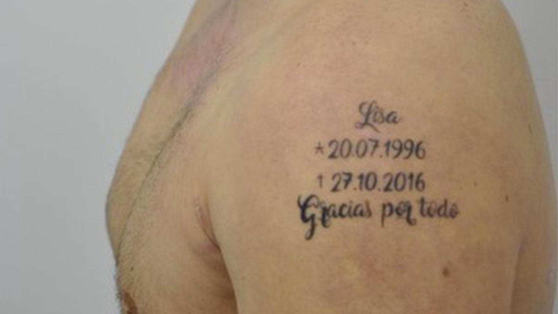 A close-up of the tell-tale tattoo. (Photo: Spain's Policia Nacional)