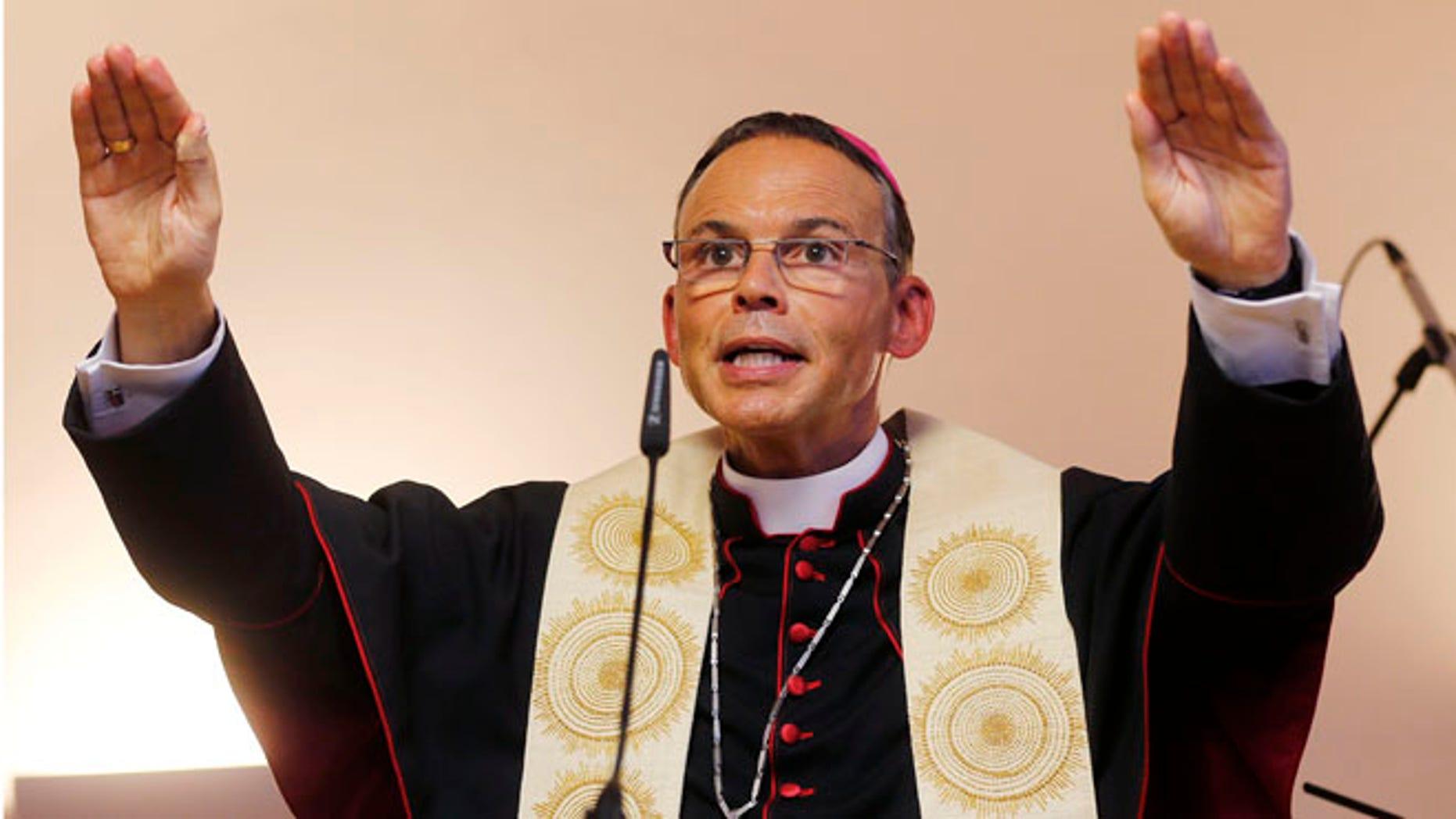Aug. 29, 2013: In this file photo the Bishop of Limburg Franz-Peter Tebartz-van Elst blesses a new Kindergarten in Frankfurt, Germany.