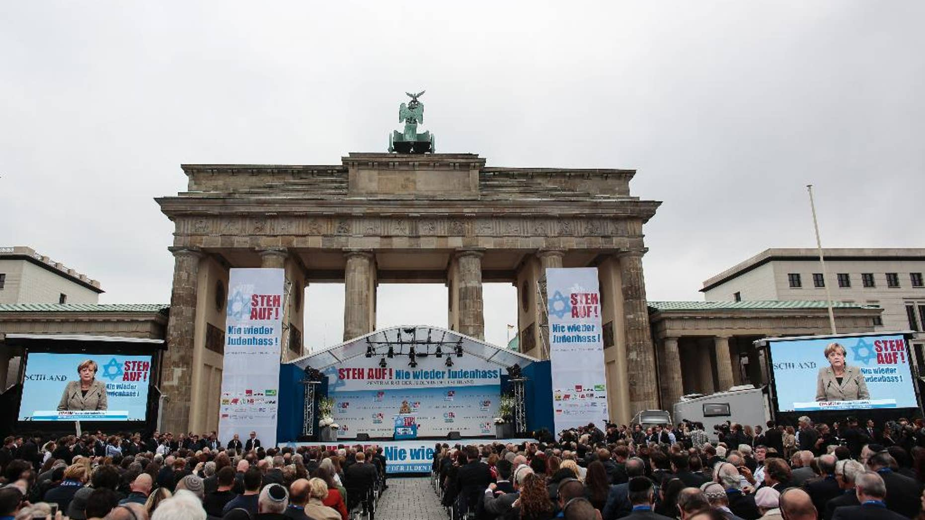 German Chancellor Angela Merkel delivers her speech at a rally against anti-Semitism near the Brandenburg Gate in Berlin, Sunday, Sept. 14, 2014.   Thousands of protesters attended  the public rally  organized  by Germany's Jewish community at the capital's Brandenburg Gate after tensions over the Gaza conflict spilled over into demonstrations in Europe that saw anti-Jewish slogans and violence. The slogan reads: Stand Up! - Jew hatred - never again!', and the name of the organizer: Central Council of Jews in Germany. (AP Photo/Markus Schreiber)