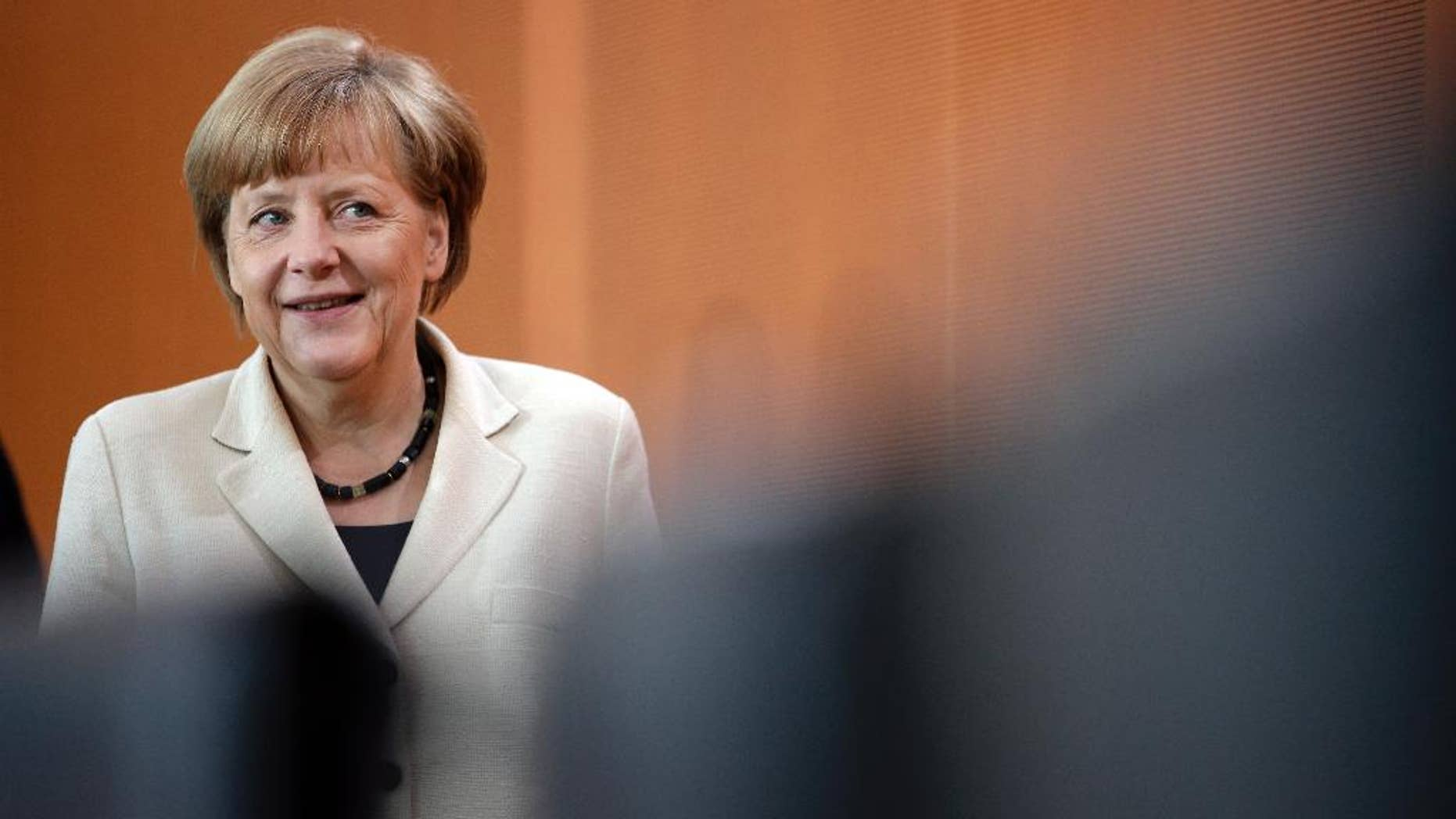 German Chancellor Angela Merkel arrives for the weekly cabinet meeting at the chancellery in Berlin, Germany, Wednesday, May 21, 2014. (AP Photo/Michael Sohn)