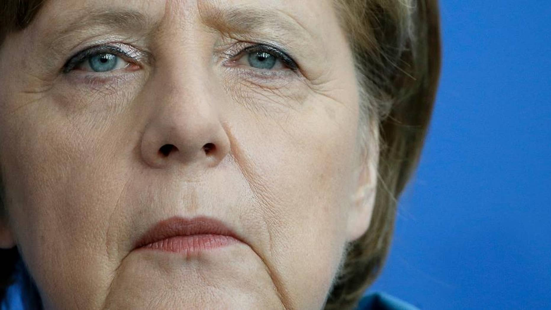 German Chancellor Angela Merkel attends a joint press conference with Prime Minister of the Czech Republic Bohuslav Sobotka as part of a meeting at the Chancellery in Berlin, Germany, Monday, May 4, 2015. (AP Photo/Michael Sohn)