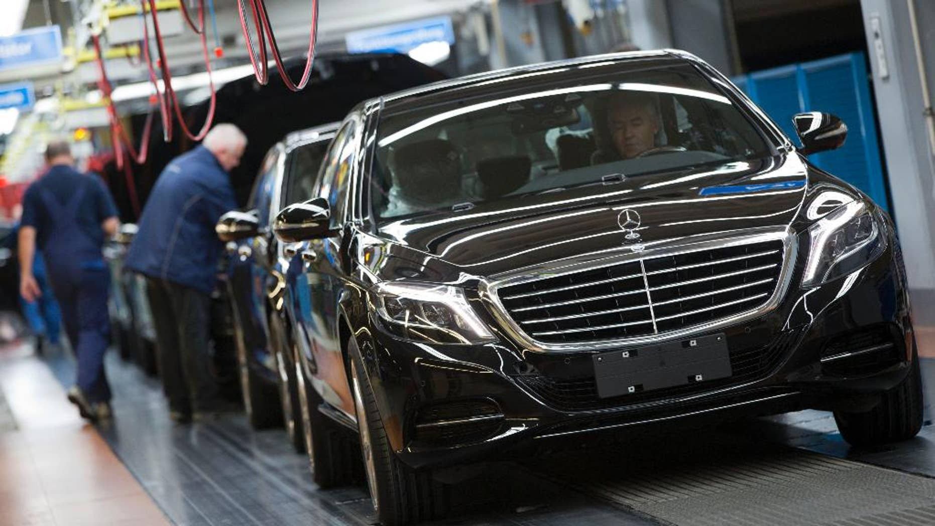 In this Jan. 28, 2015 picture an employee of the Mercedes-Benz AG checks a S-Class model at the plant in Sindelfingen, Germany. Daimler will present its second quarter earning Thursday, July 23, 2015.  (AP Photo/Matthias Schrader)