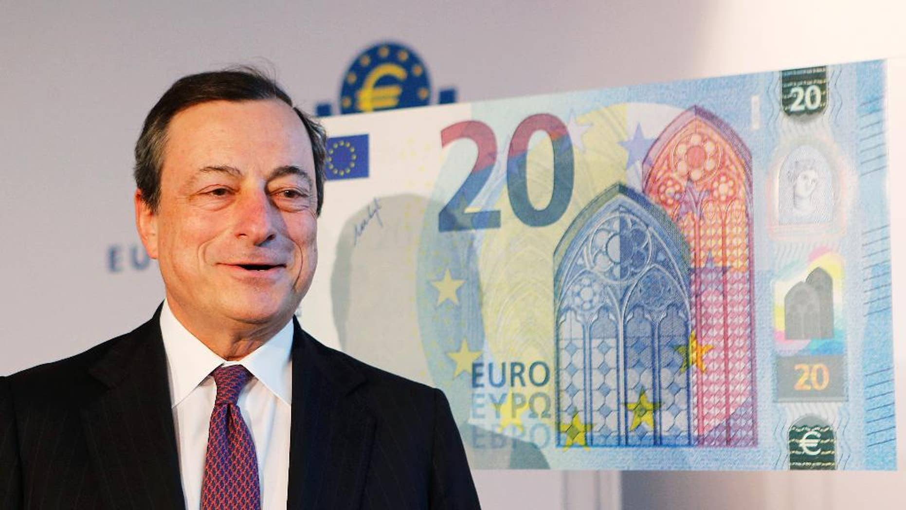 FILE - In this Tuesday, Feb. 24, 2015, file photo, Mario Draghi, president of the European Central Bank, stands next to a facsimile of the new 20 euro banknote in Frankfurt, Germany. Analysts are already talking about when and how the European Central Bank might extend its 1.1 trillion euro ($1.2 trillion) stimulus program that has been running for the past six months in an attempt to boost the modest recovery in the 19 countries that use the euro. (AP Photo/Michael Probst, File)