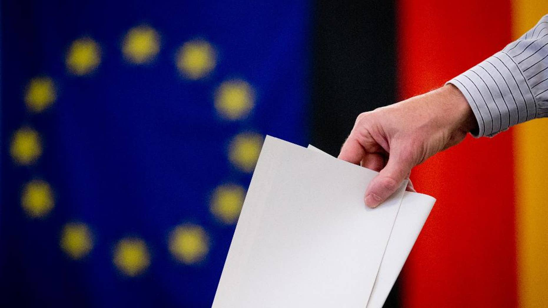 A man casts his ballot for the European elections and a local referendum on the Tempelhof field in a polling station in Berlin, Germany, on Sunday, May 25, 2014. (AP Photo, dpa,Kay Nietfeld)
