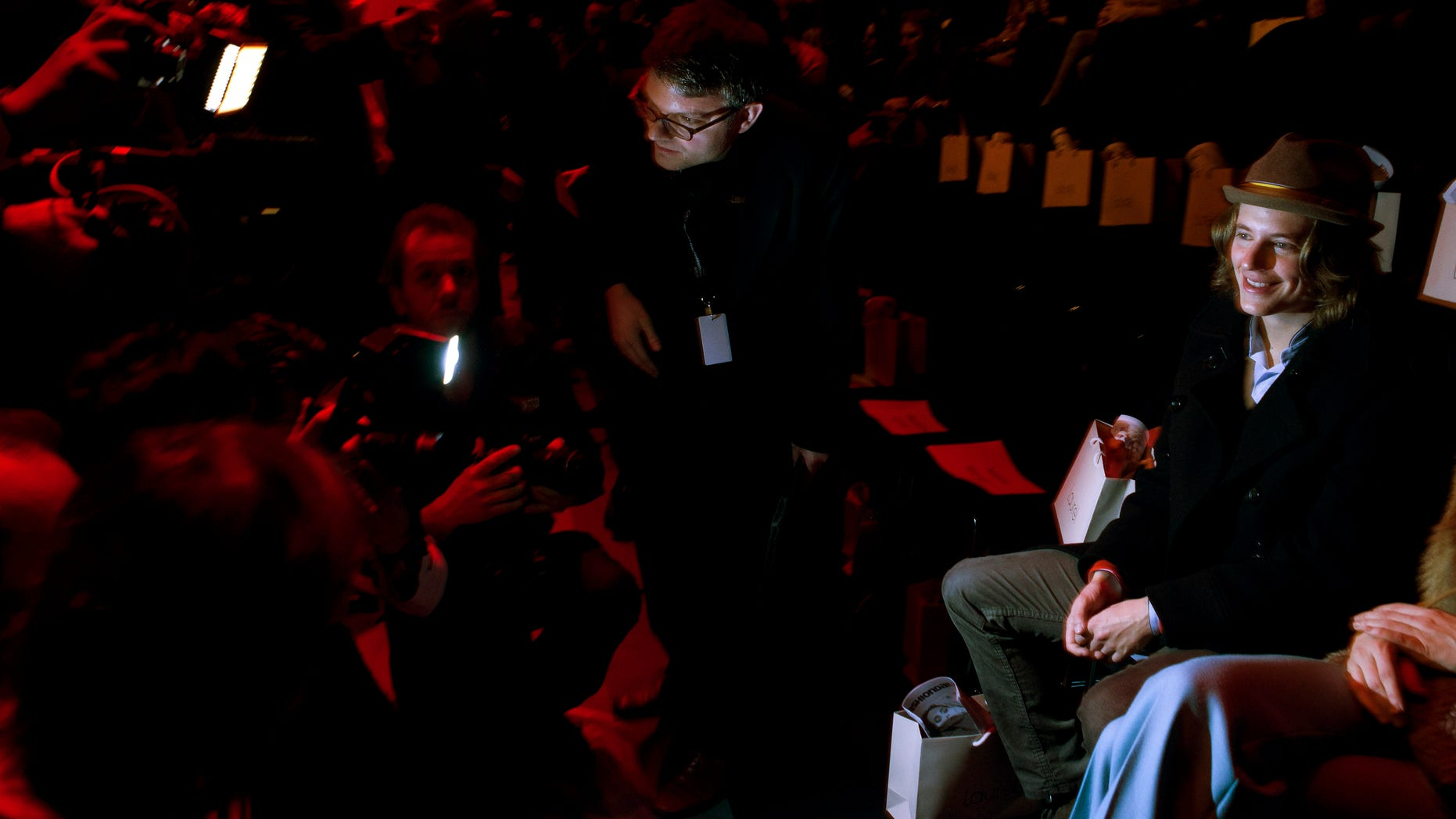Jan. 19, 2012: ierre Sarkozy, right, son of French President Nicolas Sarkozy, is surrounded by media prior to the fashion show of fashion brand Laurel at the Fashion Week in Berlin.