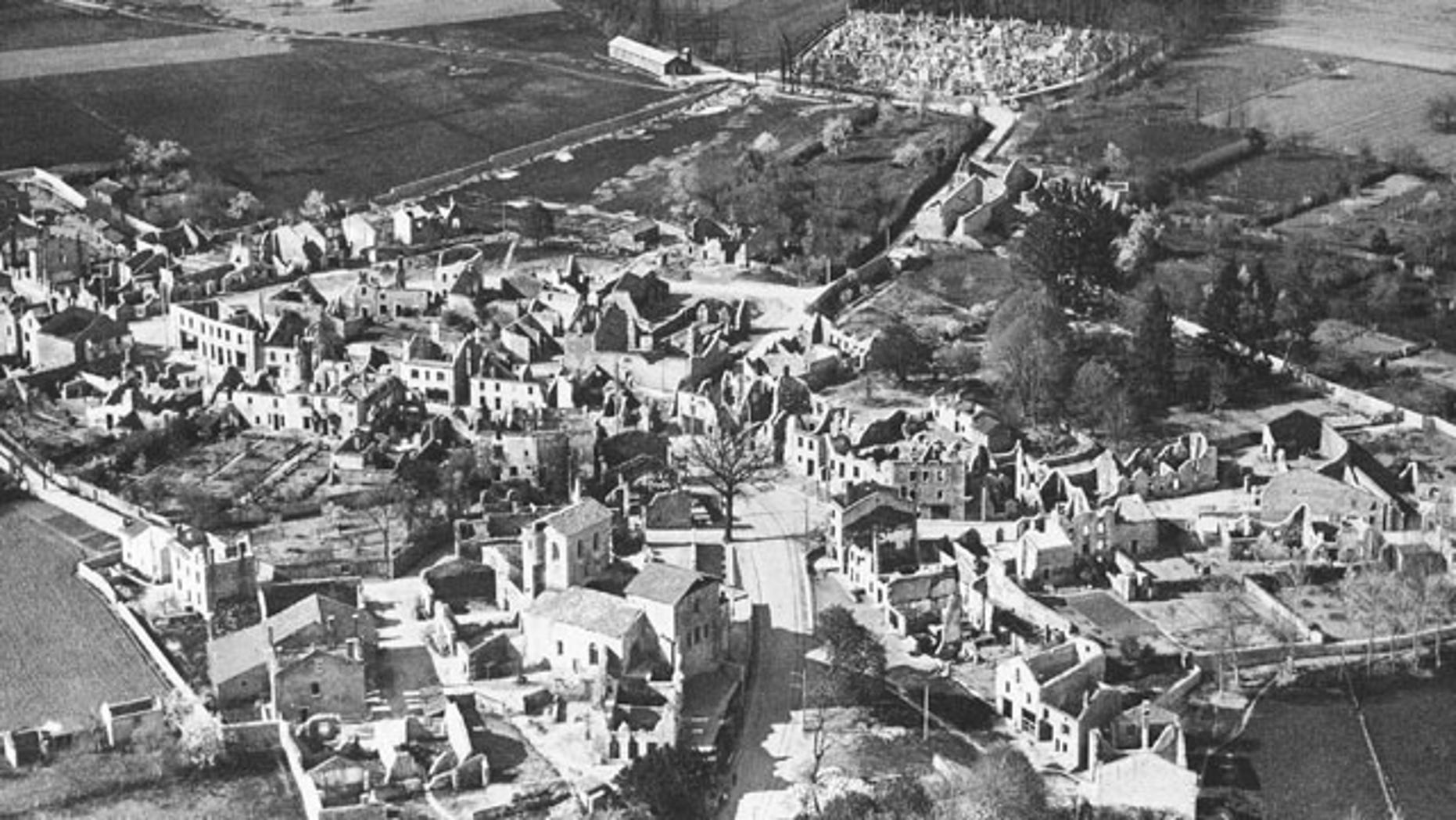 FILE - In this Jan. 1, 1953 b/w file picture, an aerial view of the destroyed Oradour-sur-Glane, in France is visible. In total, 642 men, women and children were killed here in reprisal for the French Resistance's kidnapping of a German soldier. (AP Photo,File)