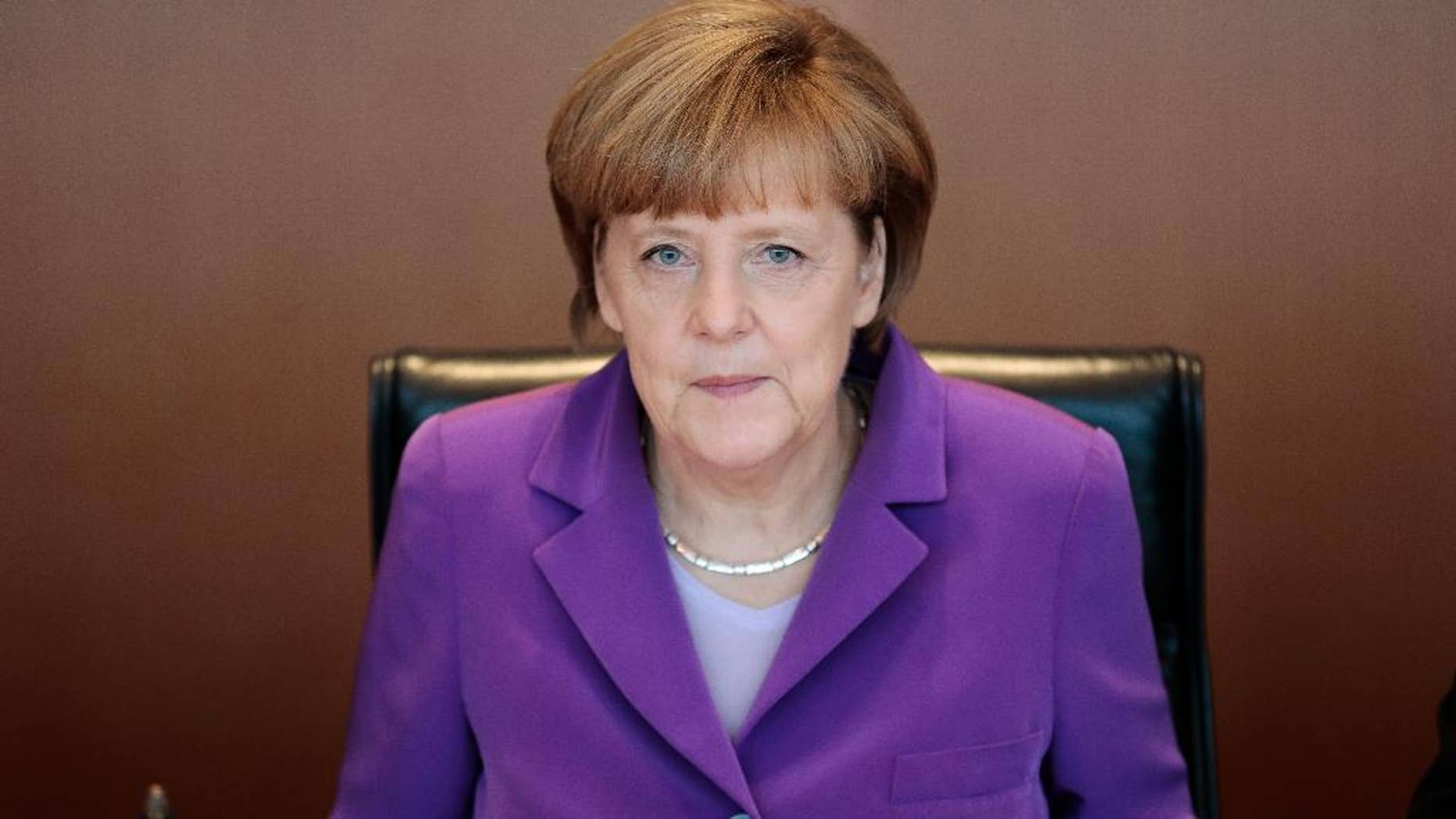 German Chancellor Angela Merkel attends the weekly cabinet meeting at the chancellery in Berlin, Wednesday, May 28, 2014.  (AP Photo/Markus Schreiber)