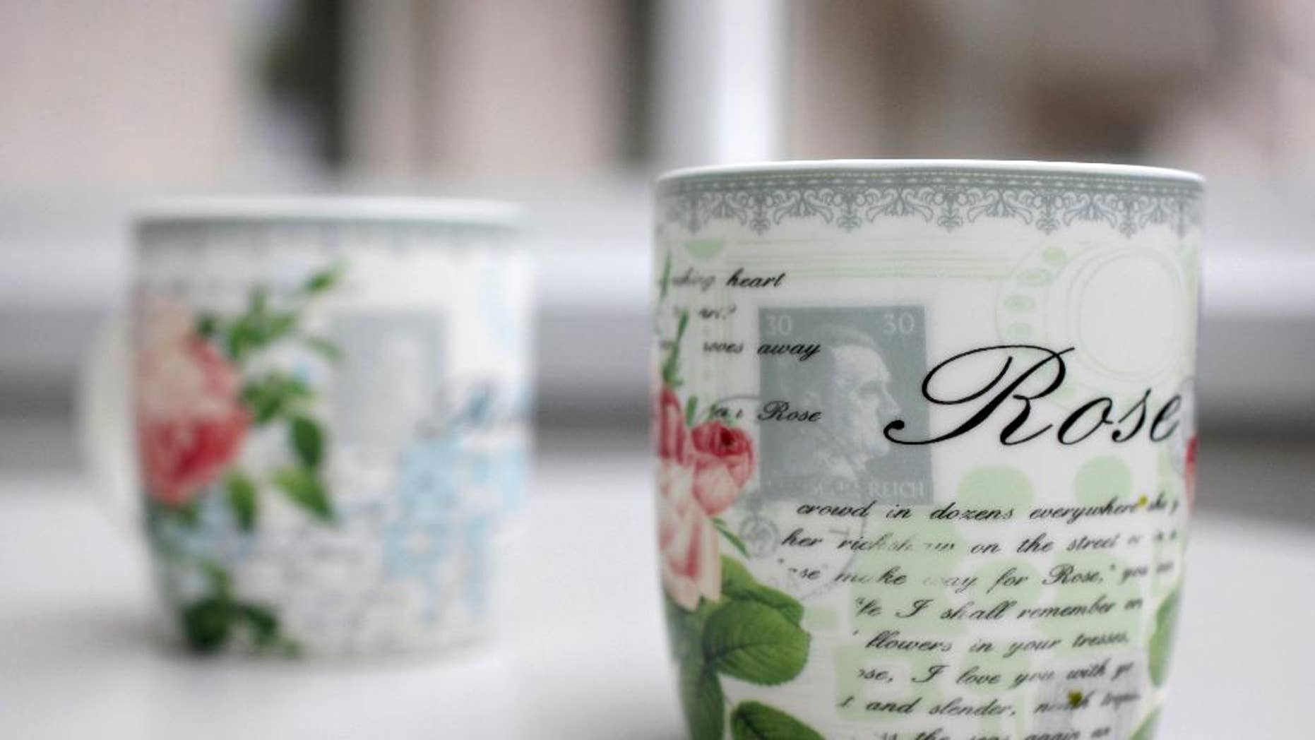 "Coffee cups with a small Hitler portrait are pictured in Bielefeld Germany, Thursday, April 10, 2014. A small German furniture chain says it inadvertently ordered several thousand of these coffee cups bearing a faint portrait of Adolf Hitler from China. Christian Zurbrueggen, co-owner of the Zurbrueggen chain, told German news agency dpa on Thursday that 175 of the offending cups were sold before customers pointed out the problem. Zurbrueggen said: ""I want to take the cups out of circulation."" The remaining 4,825 cups have been destroyed and he says he's offering a 20-euro (US dollar 27.60) voucher for the return of the others, sold for 1.99 euros each. (AP Photo/dpa, Oliver Krato)"