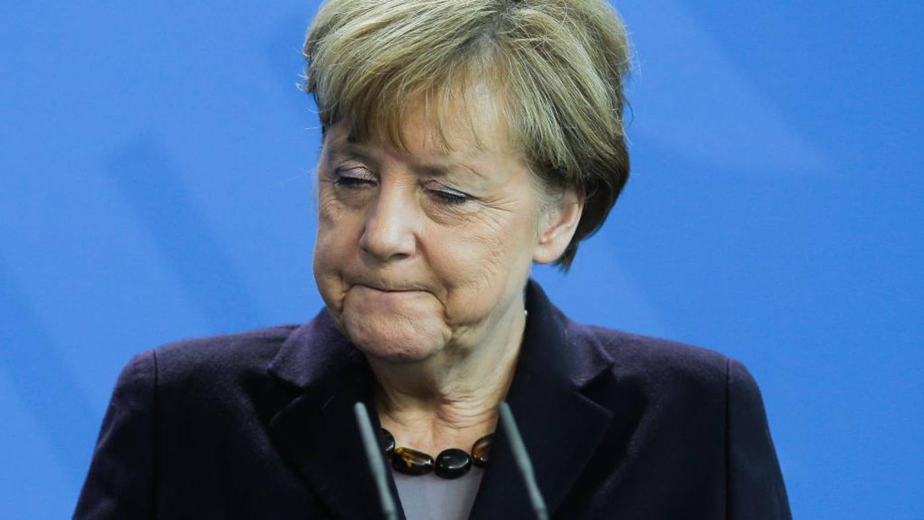 German Chancellor Angela Merkel answers  questions during a news conference with  the President of Honduras Juan Orlando Hernandez, at the chancellery, in Berlin, Tuesday, Oct. 27, 2015. (AP Photo/Markus Schreiber)