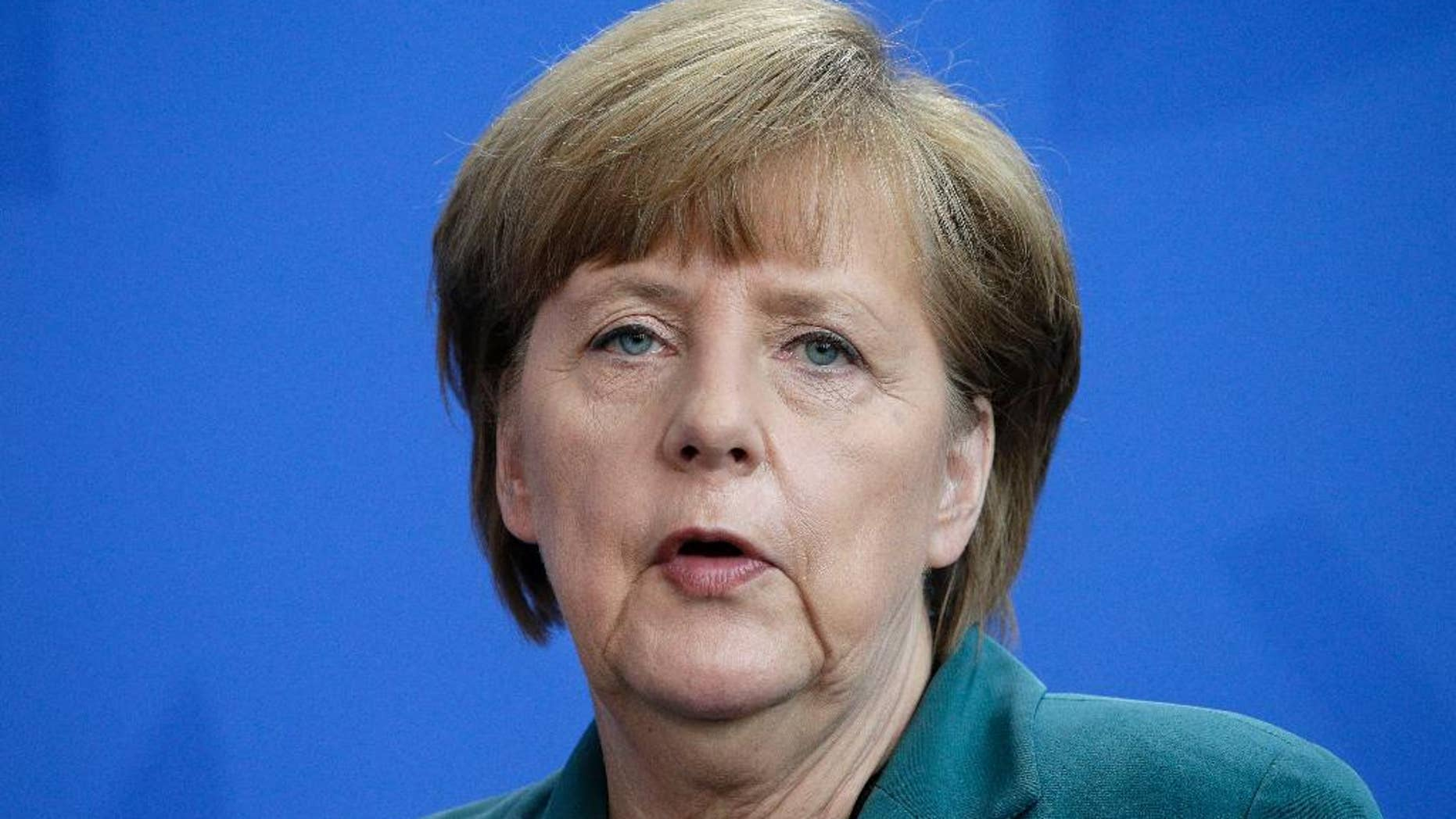 German Chancellor Angela Merkel addresses the media during a joint press conference with Prime Minister of Japan Shinzo Abe, as part of a meeting at the chancellery in Berlin, Germany, Wednesday, April 30, 2014. (AP Photo/Michael Sohn)