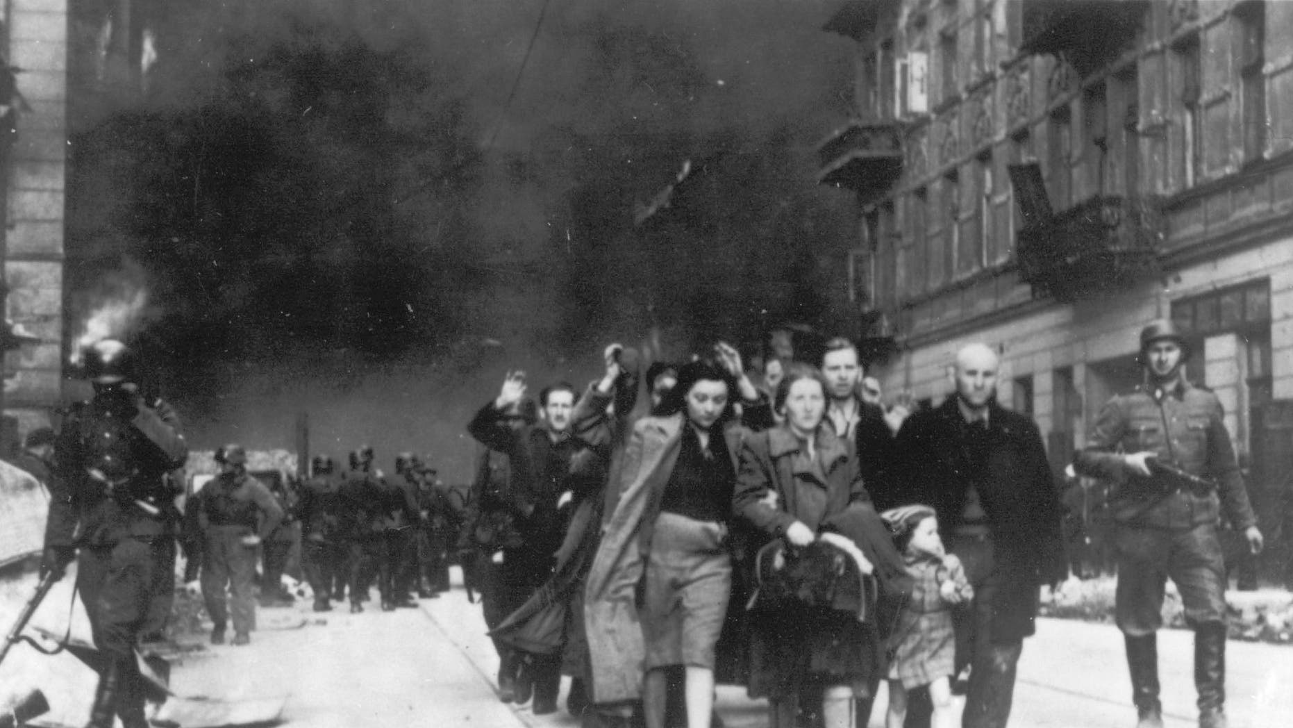 In this 1943 file photo, a group of Polish Jews are led away for deportation by German SS soldiers during the destruction of the Warsaw Ghetto by  German troops after an uprising in the Jewish quarter. German Finance Minister Wolfgang Schaeuble is to sign off officially Thursday Nov. 15 2012 on revisions to the original 1952 compensation treaty, increasing pensions for those living in eastern Europe and broadening who is eligible for payments.