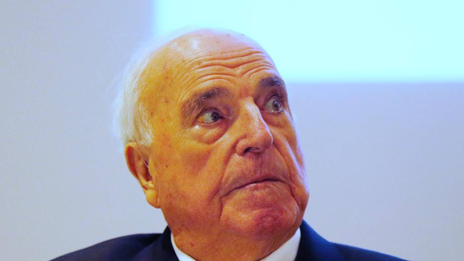 "FILE - In this Nov. 3, 2014 file picture fFormer German Chancellor Helmut Kohl looks around before he presents  his new book  in Frankfurt, Germany. A German court has handed  ex-Chancellor Helmut Kohl a victory in his fight with a one-time ghostwriter over his new book Thursday Nov. 13, 2014 . Kohl's  lawyers sought to have 115 quotes from the former leader removed from Heribert  Schwan's ""Legacy: The Kohl Records."" It's based partly on recordings of  interviews conducted in 2001 and 2002, when Kohl was under pressure in a party financing scandal, and has drawn attention for unflattering comments about other  politicians. (AP Photo/Michael Probst,File)"
