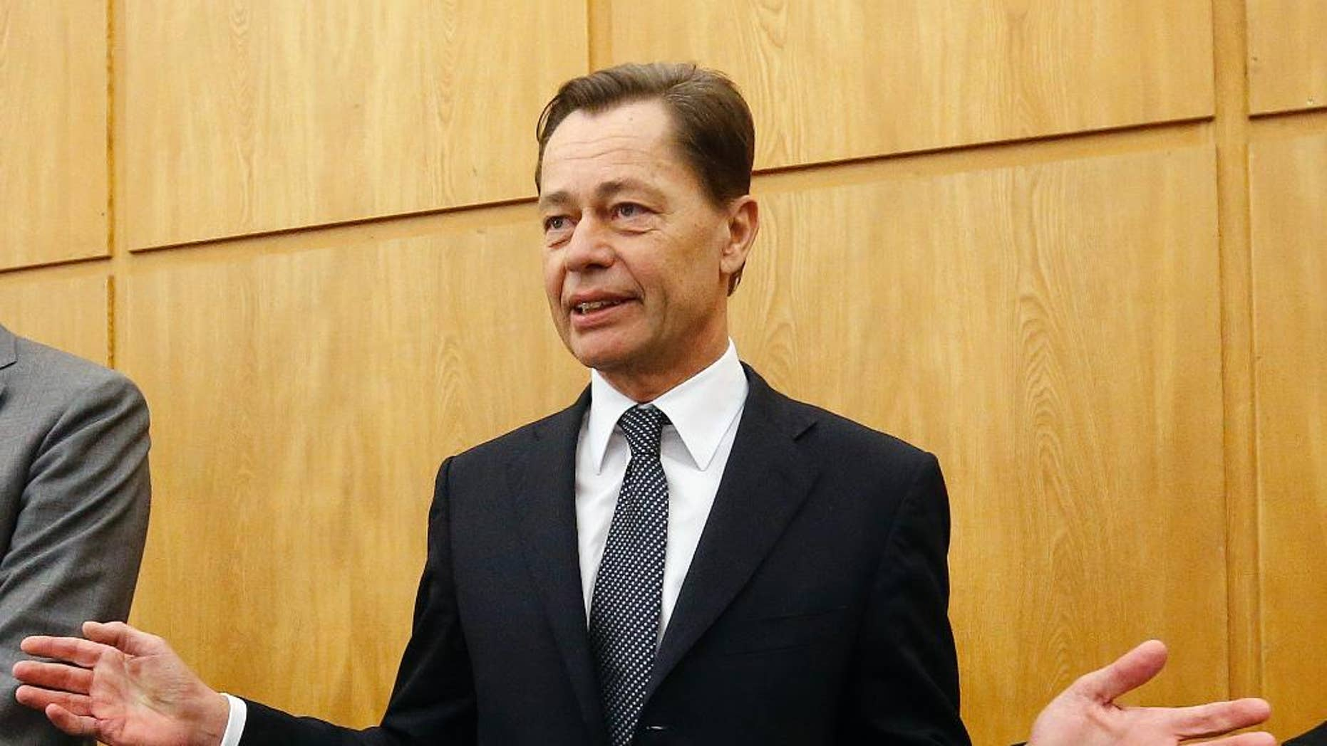 Former Arcandor CEO Thomas Middelhoff gestures in the courtroom of the district court in Essen, Germany, Friday, Nov. 14, 2014. Middelhoff is accused of embezzlement during his work for Arcandor and faces the verdict today. (AP Photo/Frank Augstein)