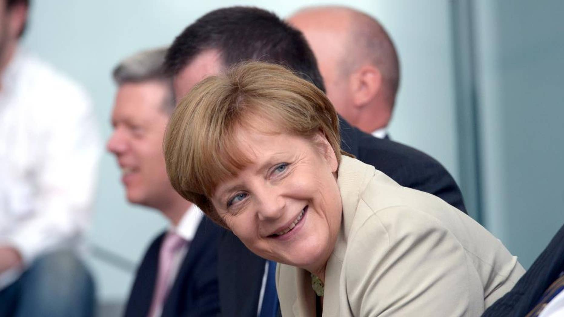 "German Chancellor Angela Merkel smiles during the award ceremony of ""startsocial Competition"" at the federal chancellery in Berlin, Germany, Tuesday, June 3, 2014. Seven projects were awarded monetary prizes of 35,000 euros in total for their commitment to civil society. (AP Photo/dpa,Rainer Jensen)"