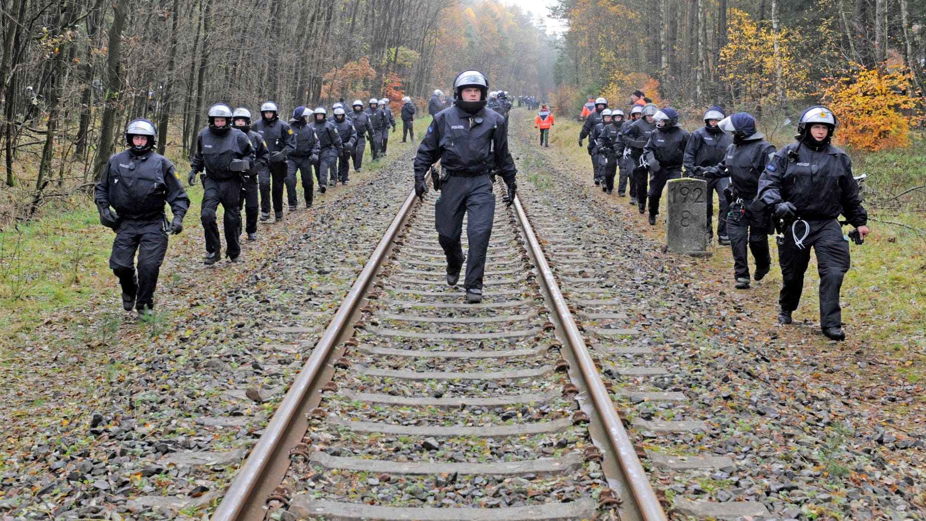Nov. 7, 2011: Police officers secure the rails near Leitstade, Germany, prior to a nuclear waste transport passing through the area. German police are preparing a big security operation to protect a shipment of nuclear waste being moved to storage site next week, as protests are expected despite a decision to speed up the country's exit from nuclear energy.