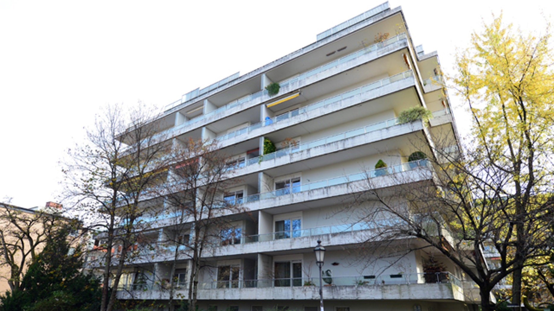 November 4, 2013: FILE -This photo shows the apartment building in Munich, Germany, where more than 1,400 artworks were found in the apartment of collector Cornelius Gurlitt. Gurlitt, a reclusive German collector whose long-secret hoard of well over 1,000 artworks triggered an international uproar over the fate of art looted by the Nazis, died Tuesday. He was 81. (AP Photo/dpa, Marc Mueller, File)