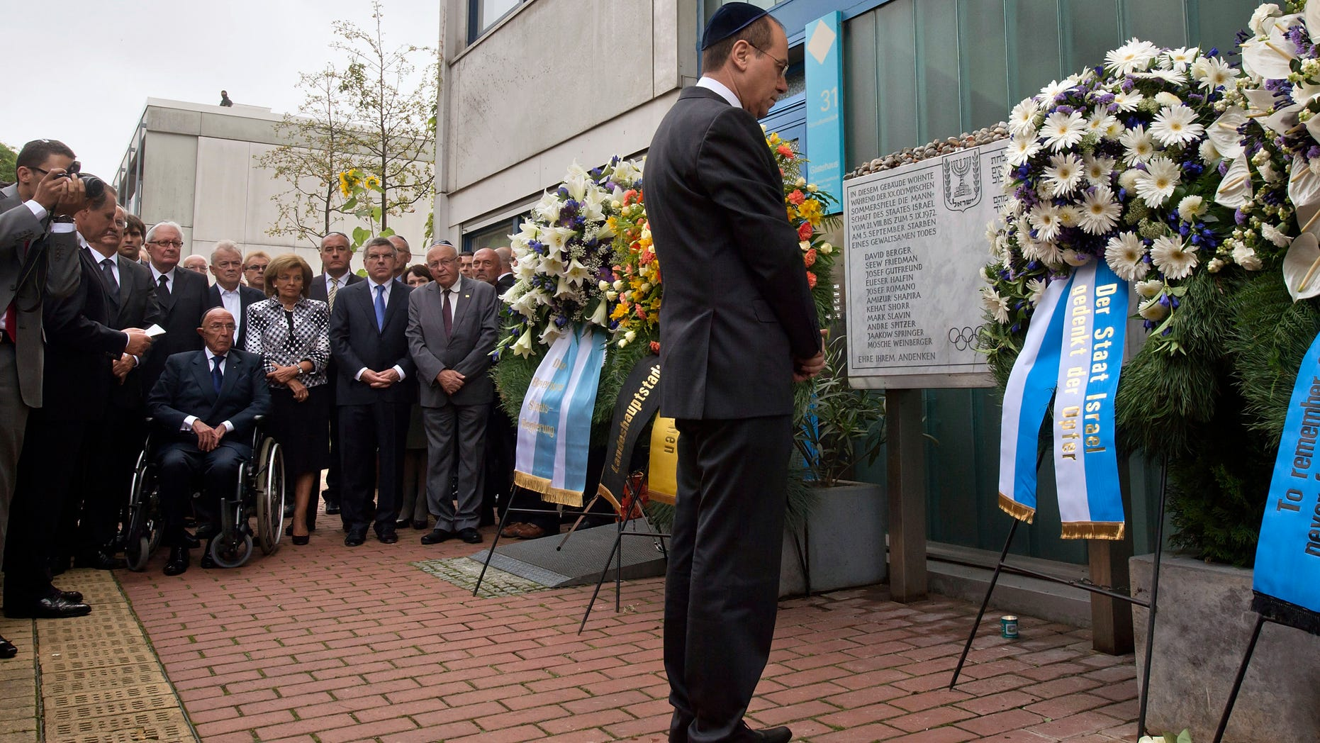 Israel's deputy Prime Minister Silvan Shalom, right, stands in front of wreaths at a memorial at the former accommodation building of the Israeli Olympic team in Munich, southern Germany, Wednesday, Sept. 5, 2012, during a commemoration ceremony for the assassination victims of the Olympic games in Munich in 1972. 17 people died in a failed liberation attempt of Israeli hostages, eleven of them of Israel's Olympic team, five terrorists and a German police officer. (AP Photo/dapd, Joerg Koch)